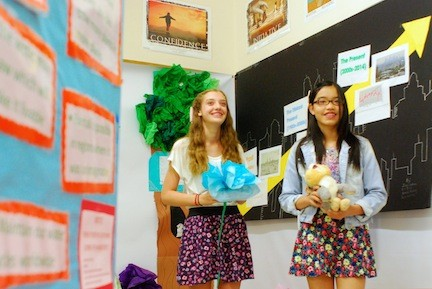 Julia Manson, left, and Jessica Zhang created an exhibit that looked at how the Industrial Revolution, which began circa 1750, spurred climate change. As part of the North Merrick WINGS program, they were two of 11 students who assembled a climate change museum last Thursday.