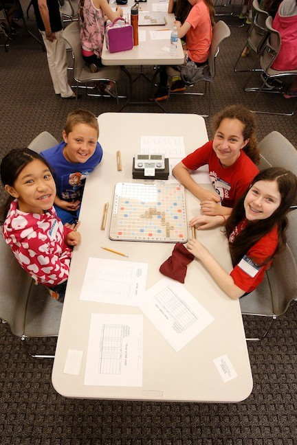Isabella Mra and Patrick Sanchez, fifth-graders at Fayette, left, and Rhiannon Bradley and Jessica Mark, fifth-graders at Levy-Lakeside School, right, flashed smiles.