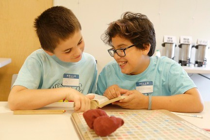 Jackson Sussman and Jordyn Schneider, fifth-graders at Merrick�s Progressive School of Long Island, scoped out words in a dictionary before a Scrabble game started.