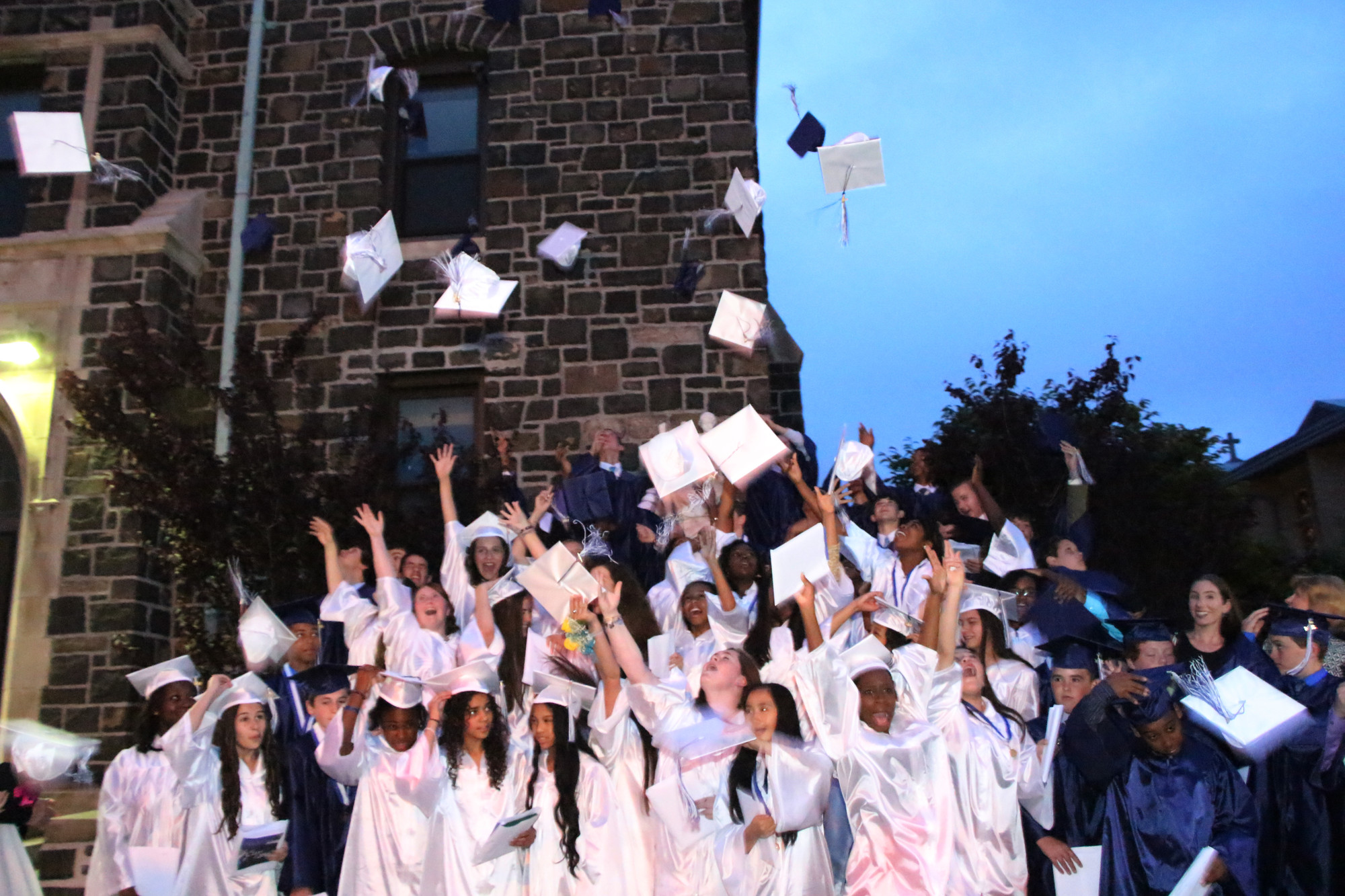 St. Christopher's Class of 2014, tossed their caps into the sky last week following their graducation ceremony.