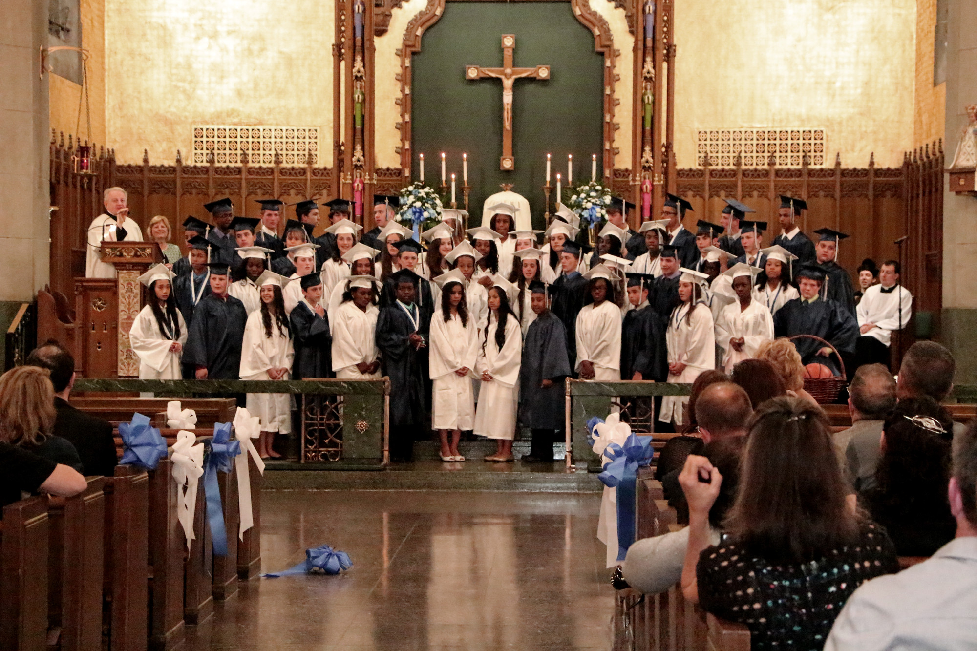 Graduates closed the cermoniy with a rendition of their school song.