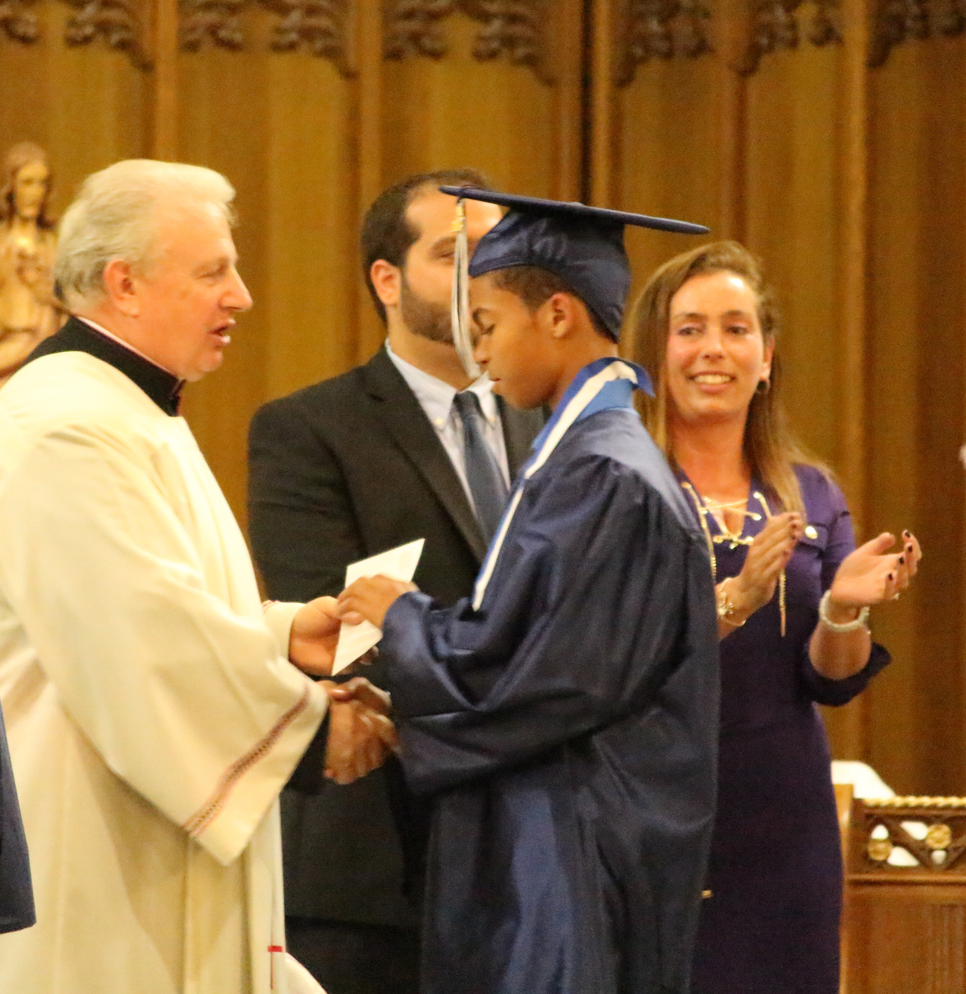 Rev. Msgr Steven Camp congratulated Tyler Walker on his achivement.