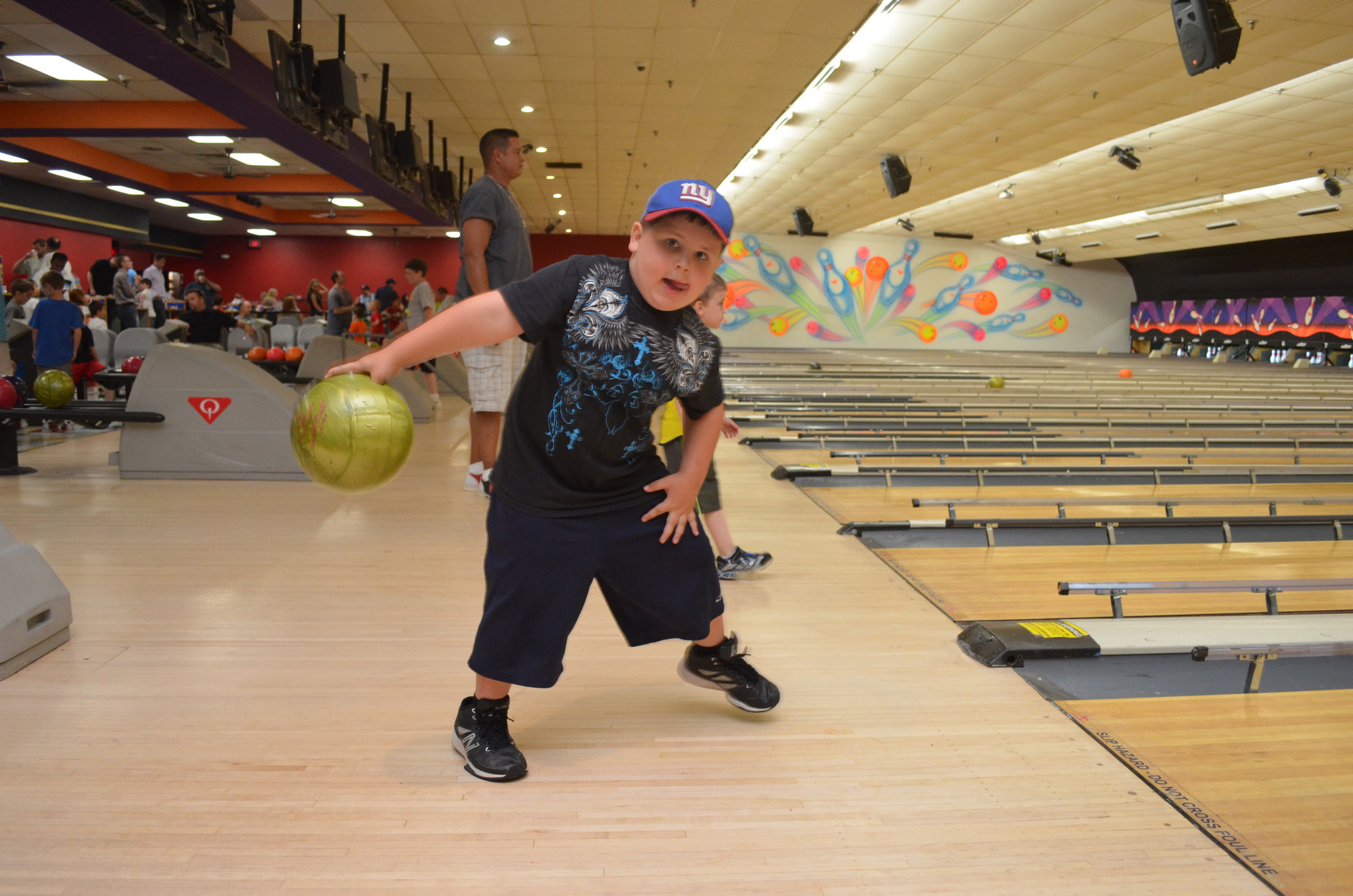 Dominic Longardino, 5, aimed for a strike.
