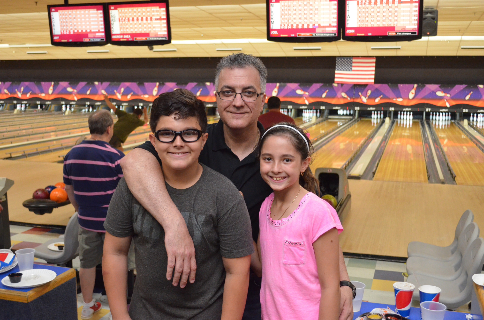 It was a happy father's day for Peter Strifas, who smiled with his daughter, Taylor, 9, and son, John, 10.