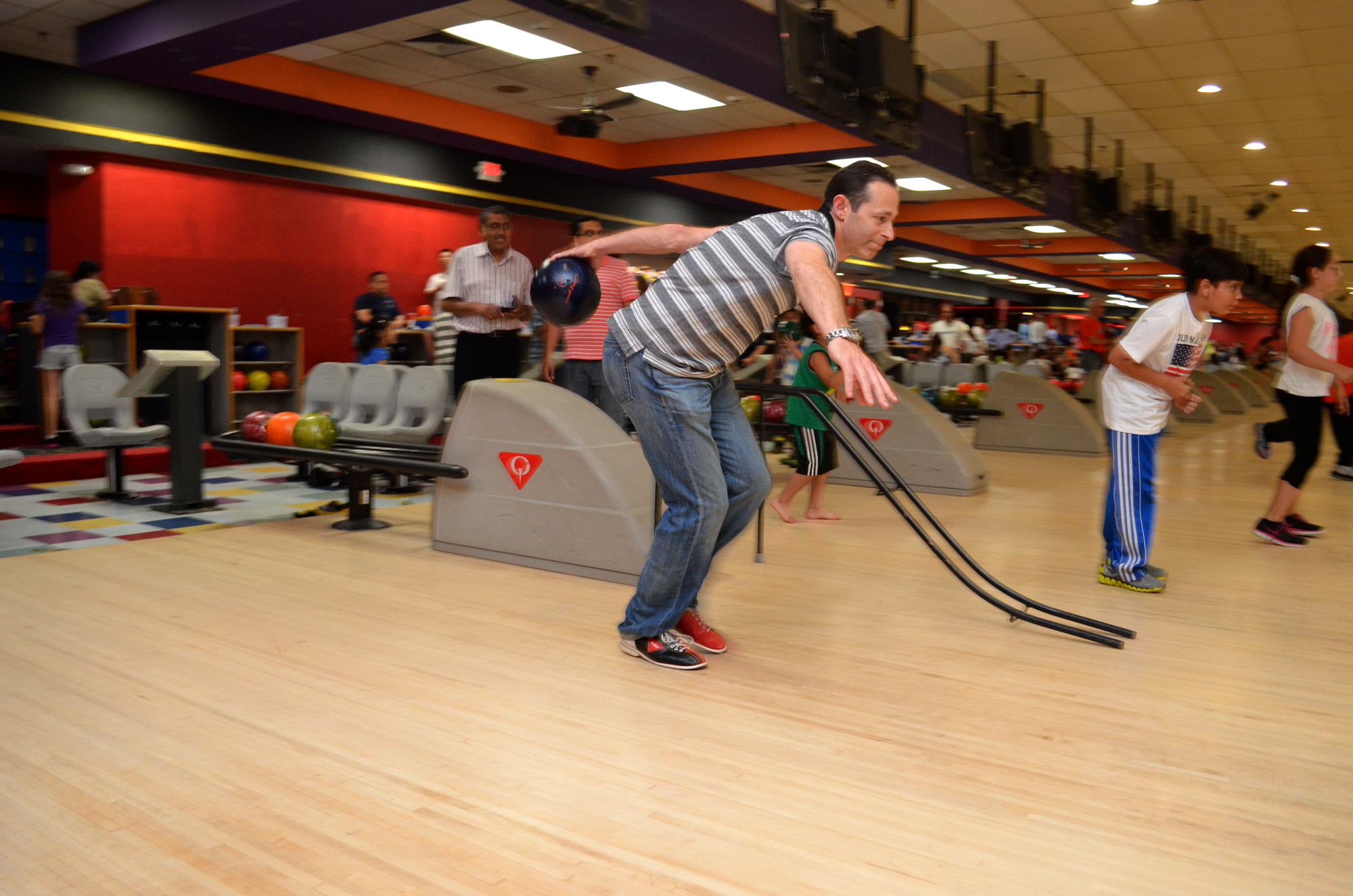 Adam Ashe lined up his shot at the Barnum Woods PTA�s Father�s Day bowling night.