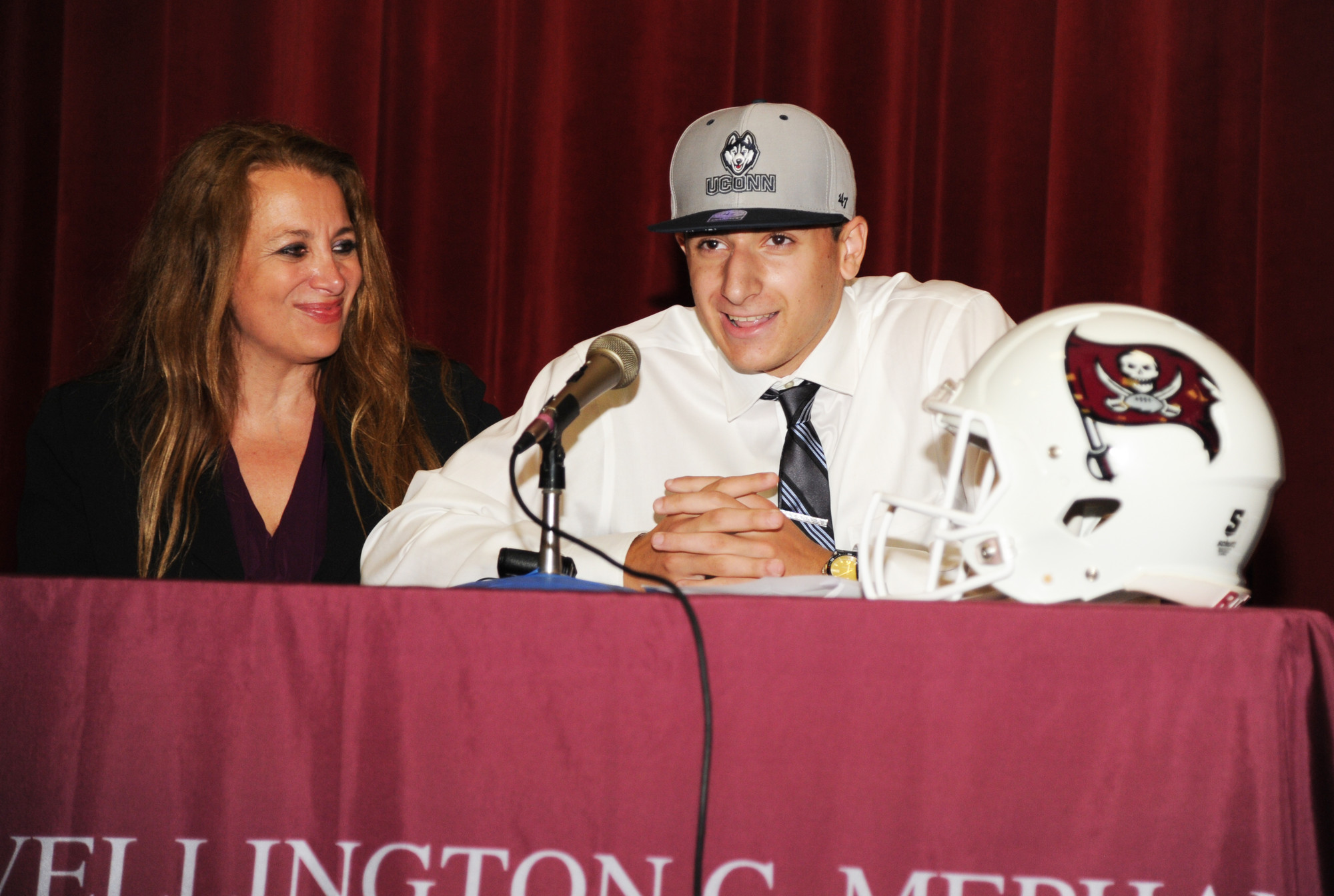 Mepham junior quarterback Tyler Davis, with his mother, Cindy, at his side, declared he's headed to the University of Connecticut on a football scholarship.