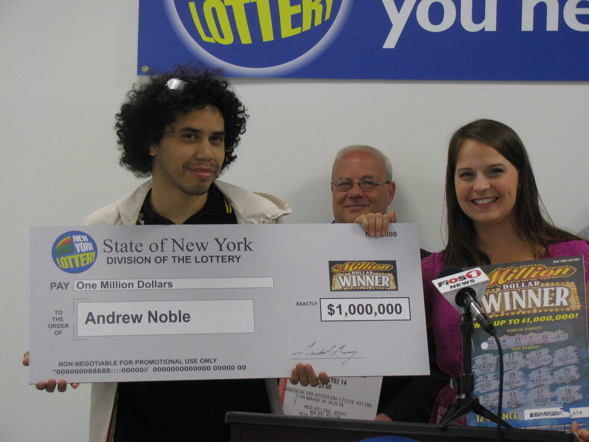 Flashing a smile that says it all, Oceanside's Andrew Noble was the first Millon Dollar Lottery winner.