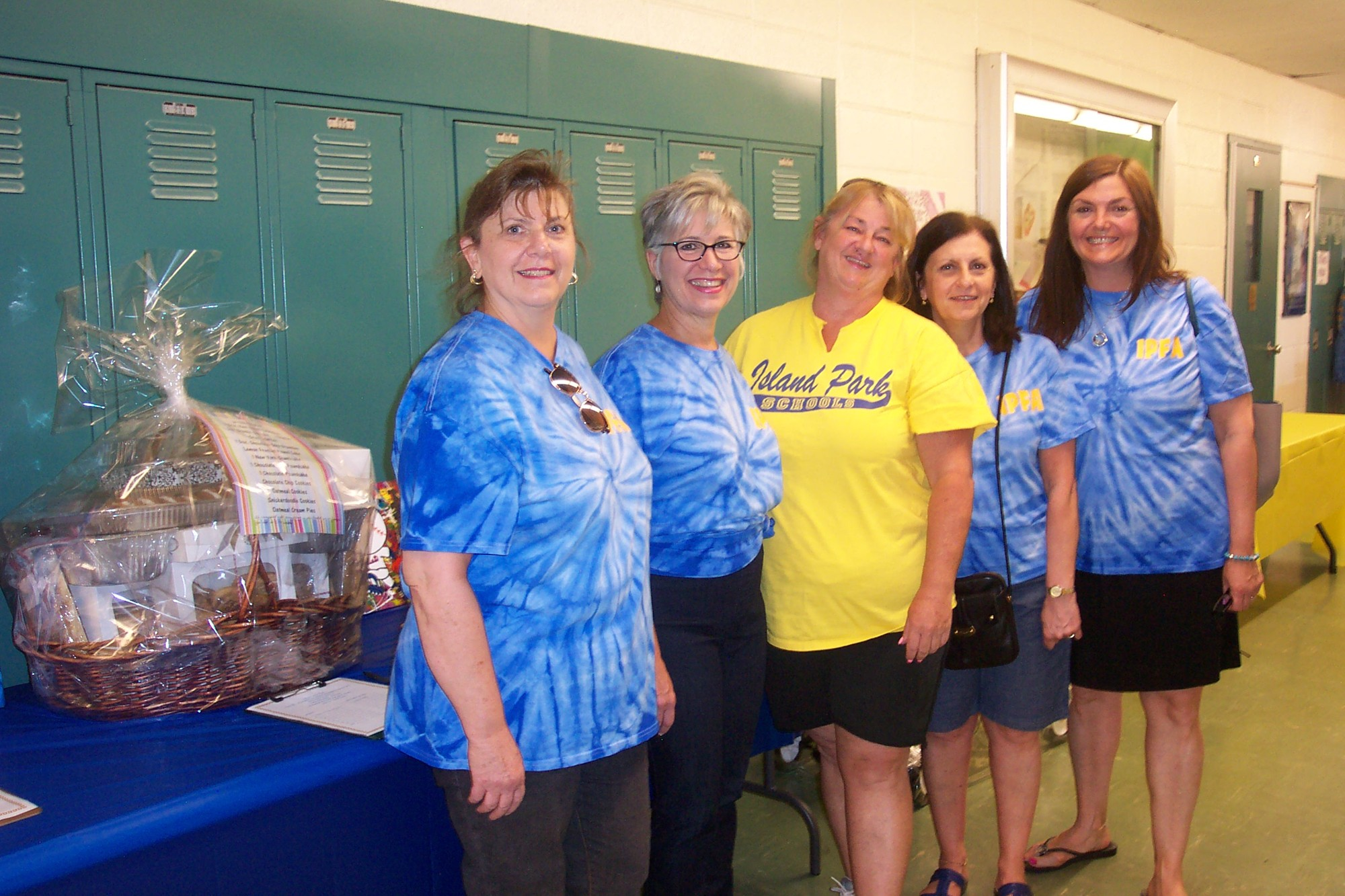 At Island Park School District's Community Day, teacher Lori Strejlau, Superintendent of Schools Dr. Rosmarie Bovino, Cathy Wirtz and school board trustees Diana Caracciolo and Tara Byrne.