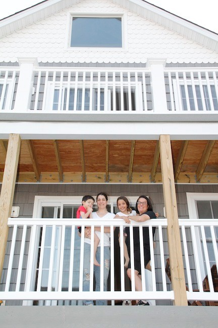 The Gallo family, from left, Lorenzo, Desiree, Alex and Sam, on the balcony of their rebuilt Pennsylvania Avenue home.