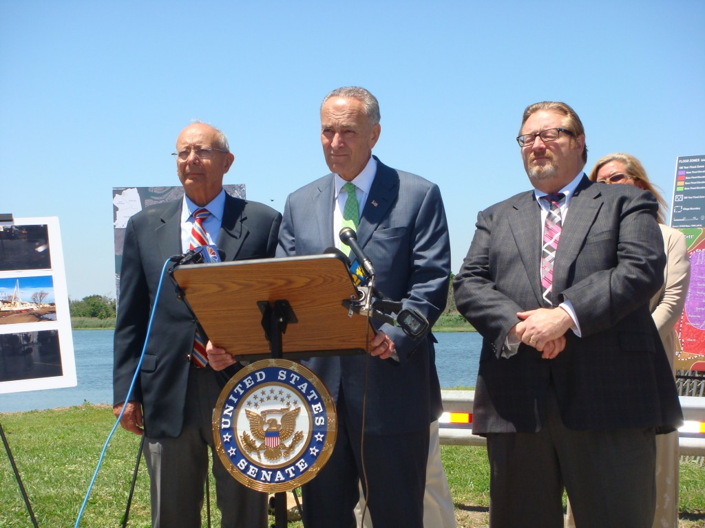 Former Senator Alfonse D'Amato, left, New York Senator Chuck Schumer and Island Park Mayor Michael McGinty, at a press conference at which Schumer promised to expedite a $40 million storm mitigation proposal.