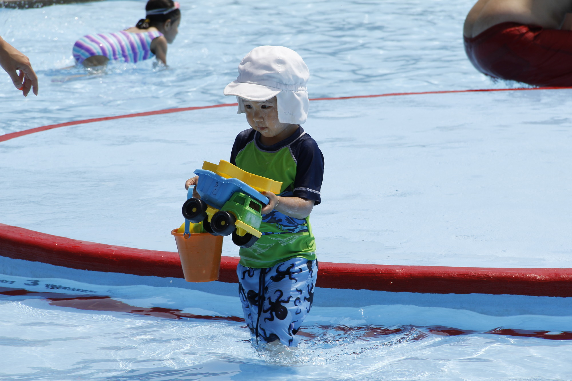 Blake Chung, 3, played with his toys until it was time to leave the pool for a snack.