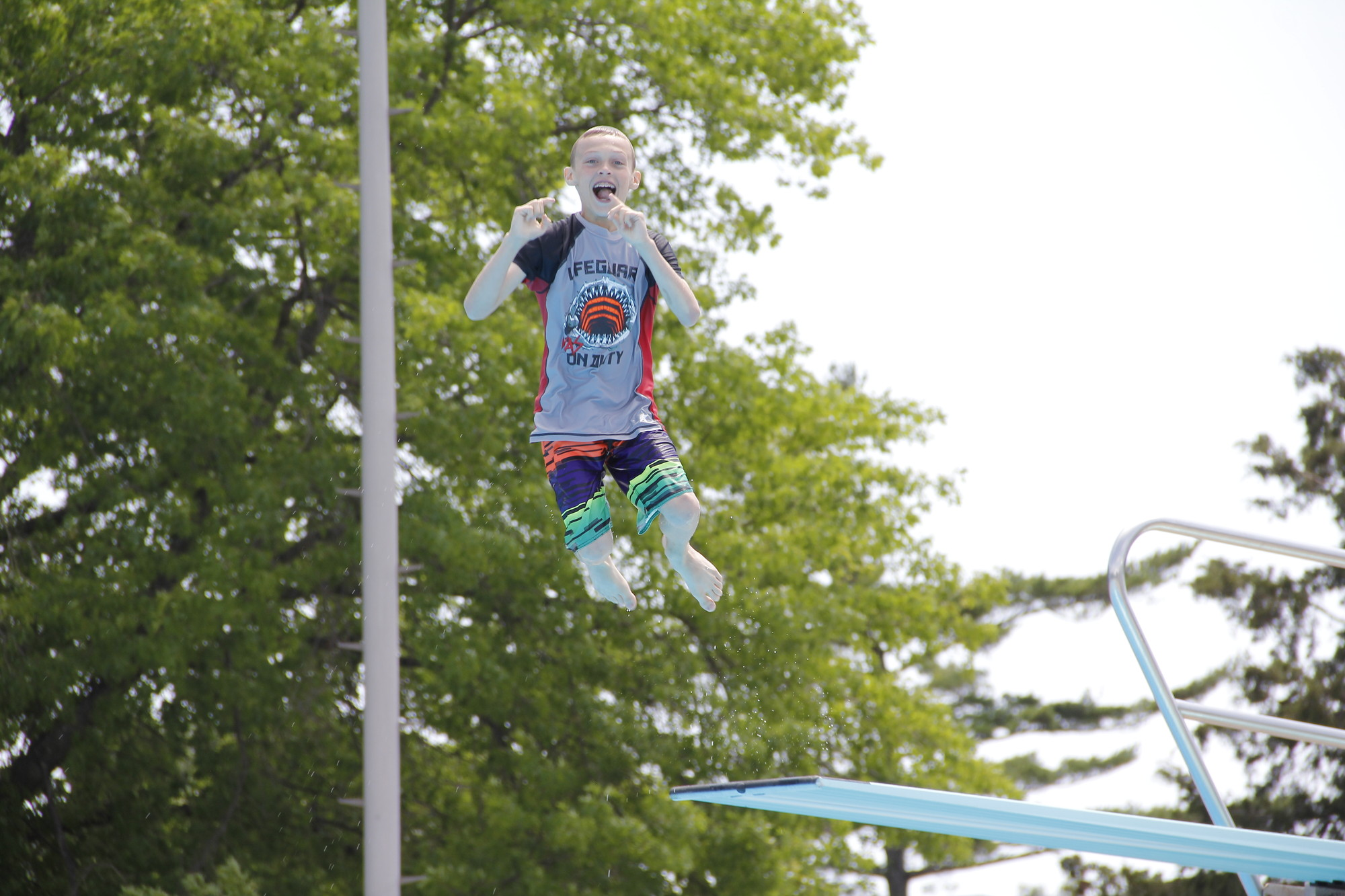 Anthony Cavanagh, 12, jumped, spun, dove and even posed for the camera on his various jumps off the diving board