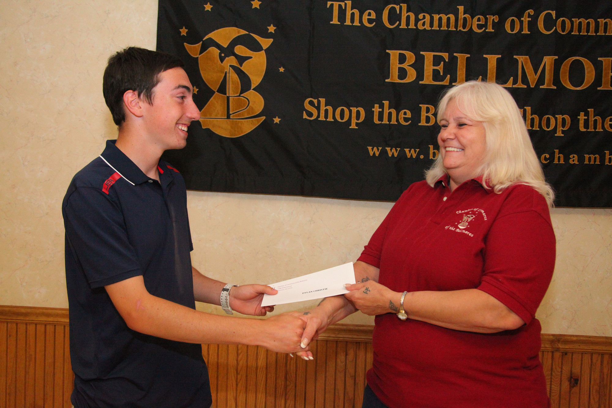 Dylan Christie, a Mepham, student, received a $500 check from the chamber