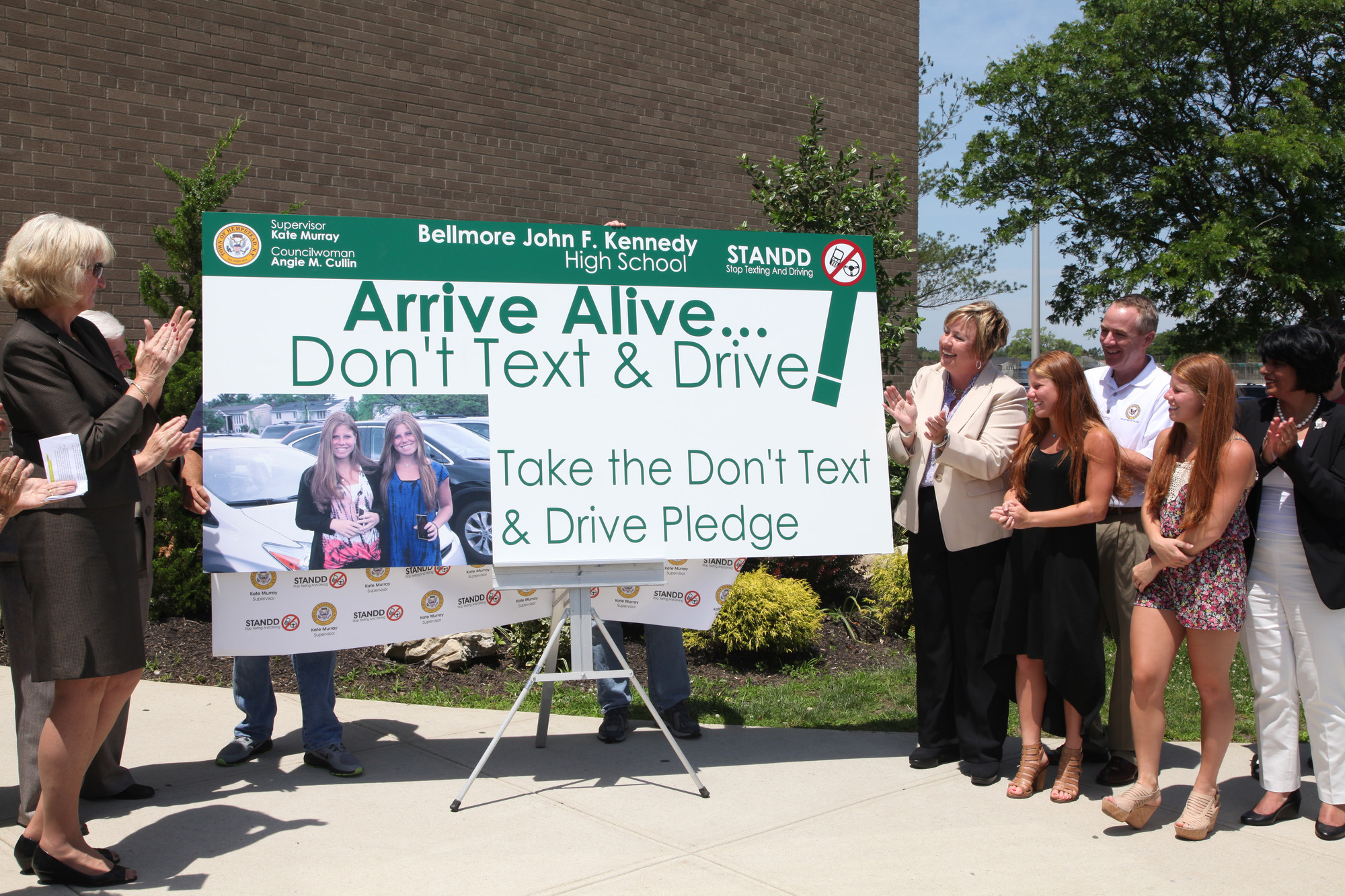 A sign produced by town workers that Hempstead Town Supervisor Kate Murray said will be seen by hundreds of students daily at Kennedy High School was unveiled on June 18 – the kickoff of a new public awareness campaign about texting and driving.