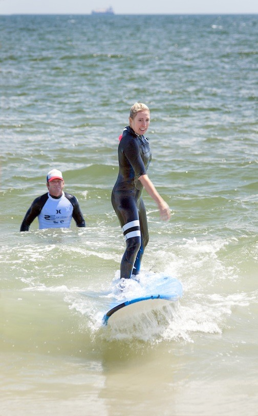 Laurel Pantin caught a wave with help from Skudin Surf co-owner Cliff Skudin.