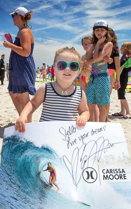 Stella Sakulak, 3, received a signed poster by pro surfer Carissa Moore.