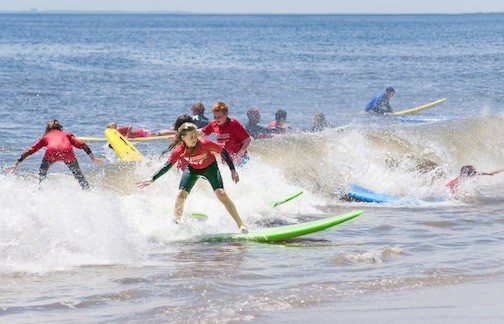 Lizzie Schmidt, 11, was among the more than 300 people who learned how to surf last week.