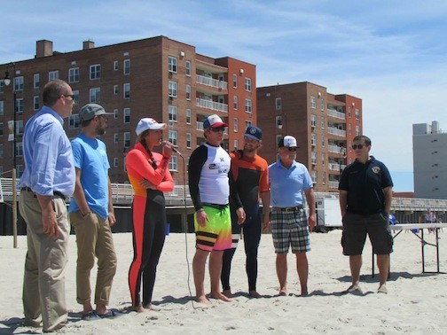 Corey Klein, far left, pro surfers Mikey DeTemple, Carissa Moore, Cliff and Will Skudin, with Steve Kohut and City Manager Jack Schnirman at International Surfing Day on June 20.