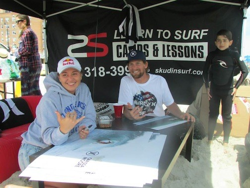 Pro surfers carissa Moore and will Skudin signed autographs on the beach.