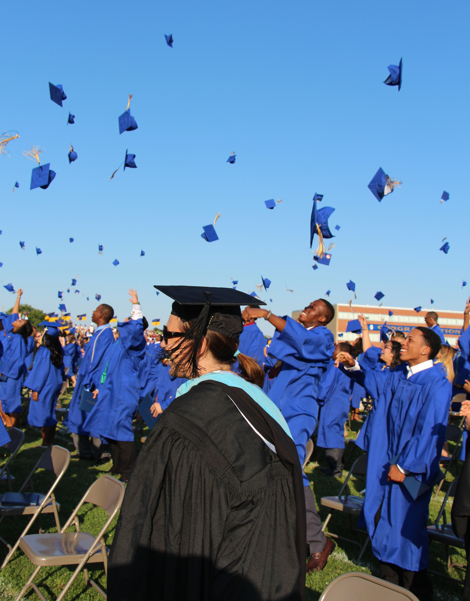 Graduates tossed their hats and were all smiles on June 27.