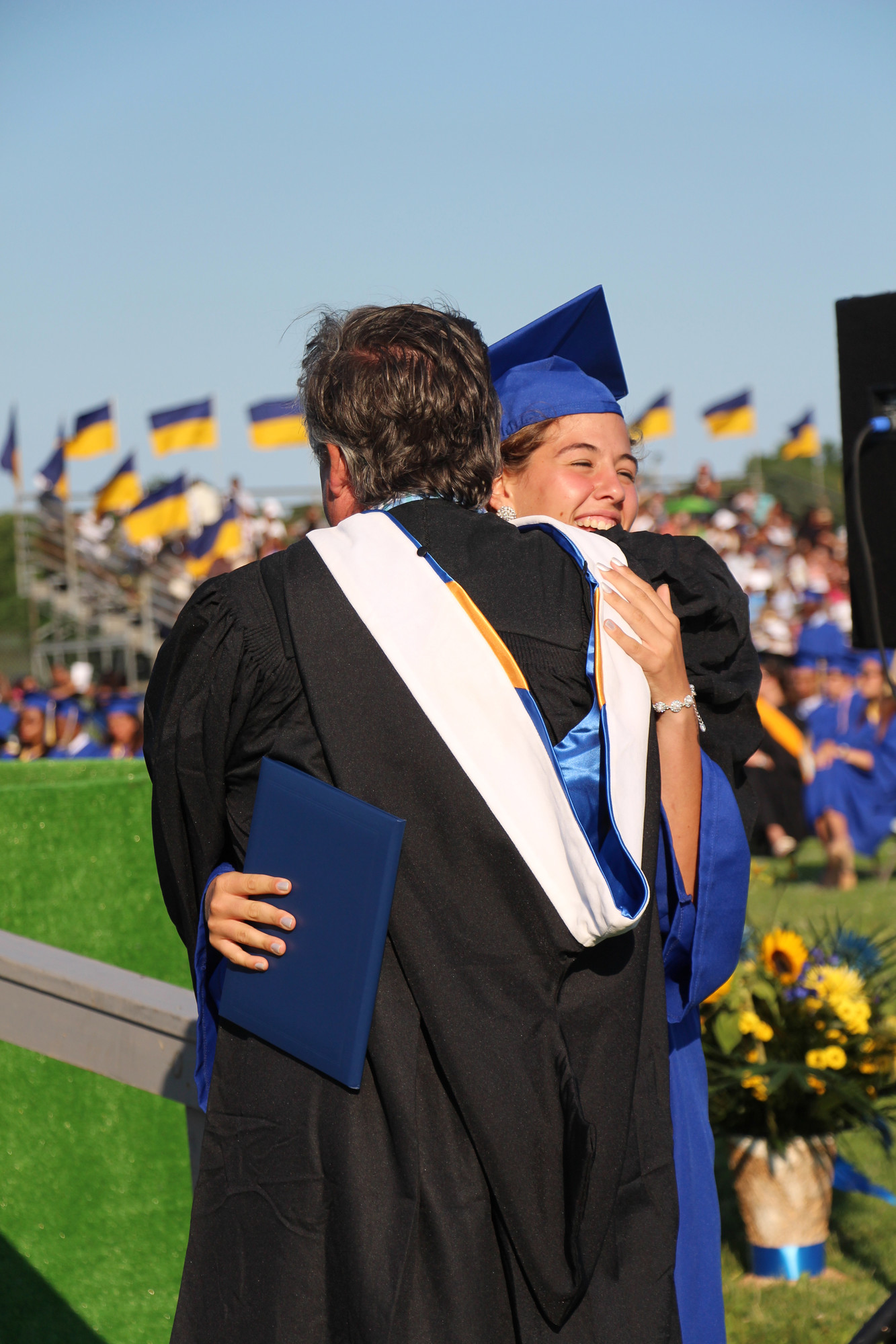 Brittney Scannell got her diploma, then got a big hug from her uncle, Superintendent James Scannell.