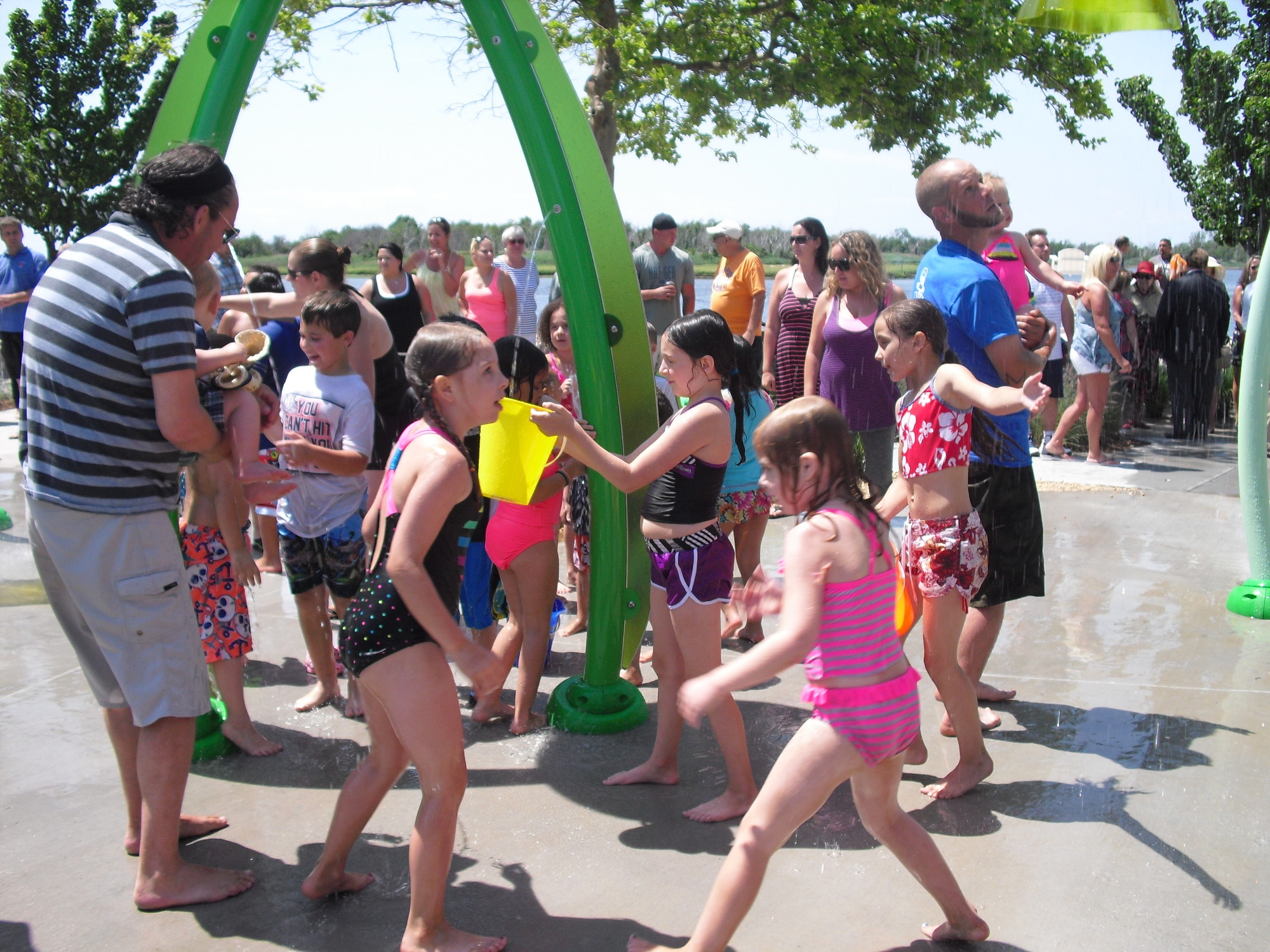 Children played in the new splash park on Masone Beach, a gift to Island Park from the Antoinette & Armand D'Amato Family Foundation.