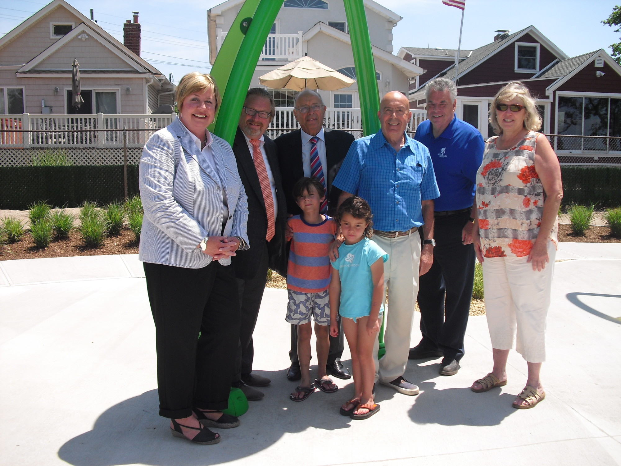 Town of Hempstead Supervisor Kate Murray, left, with Island Park Mayor Michael McGinty, Senator Alfonse D'Amato, former Assemblyman Armand D'Amato, Congressman Peter King and Nassau County Legislator Denise Ford. Front row: Alfonso and Luciana D'Amato at the splash park opening.