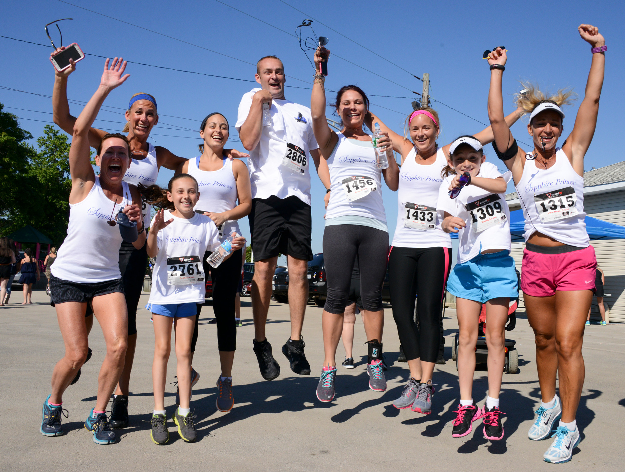 Runners from Team Sapphire Princess of Freeport were all pumped up at the Gubelli 5k in Island Park.