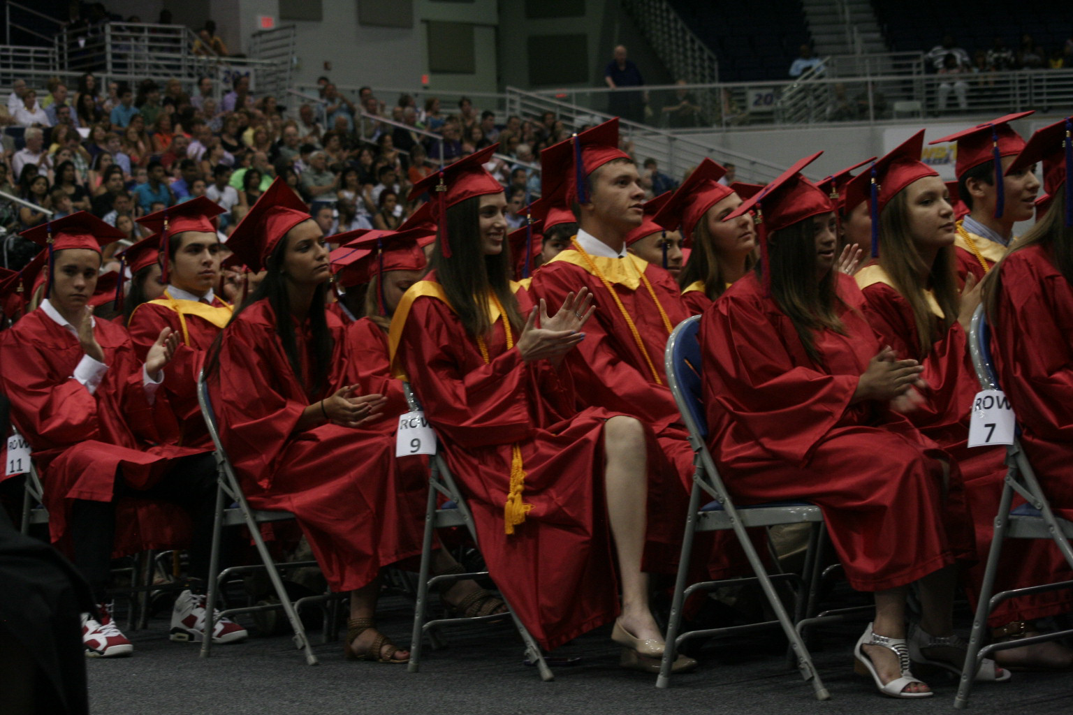 Students clapped for the speakers at the graduation ceremony, held at Hofstra University.