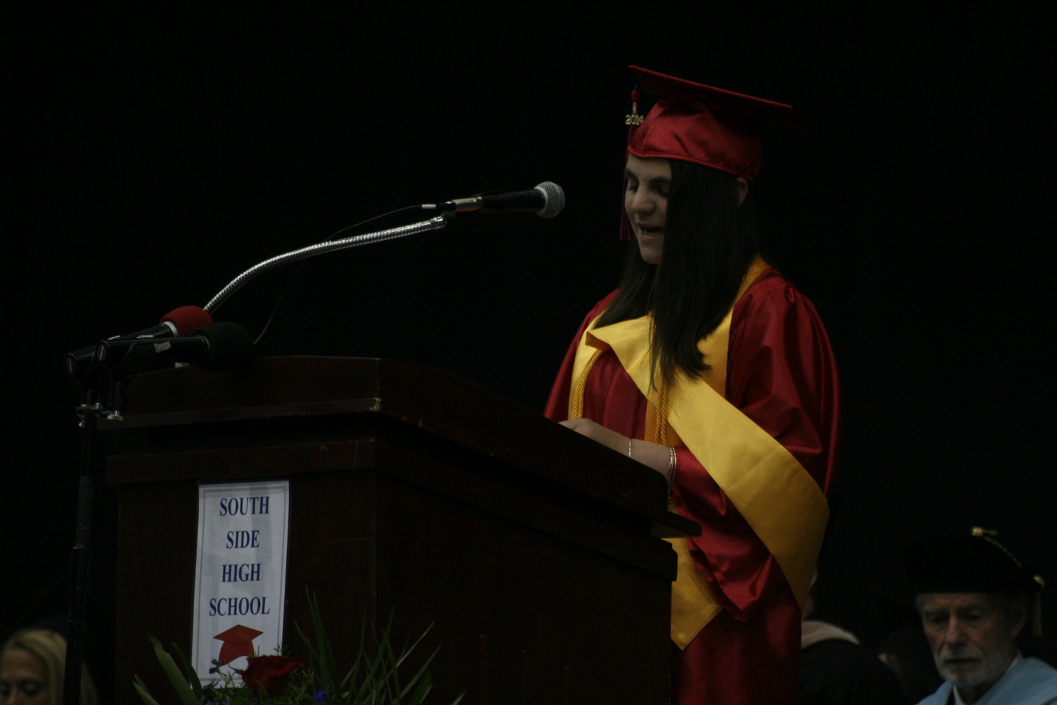 Valedictorian Meghan Connelly spoke to her peers about the importance family played in their high school success.