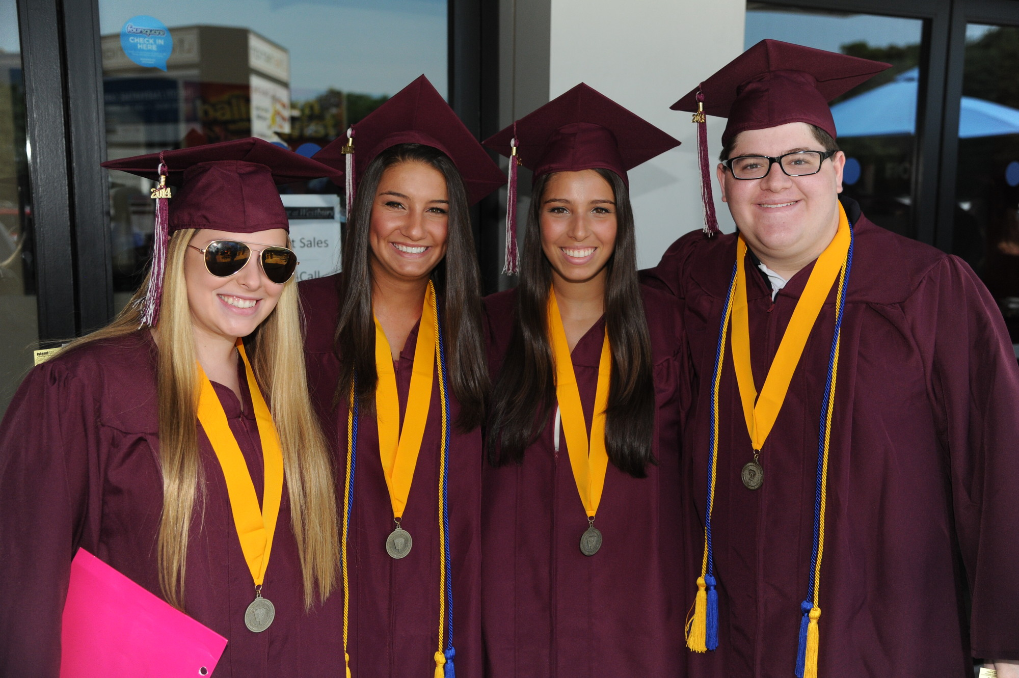 Class President Rachel Fain, Secretary Victoria Ponce, Vice President Samantha Scoca and Treasurer Daniel Gluck led their classmates into the NYCB Theatre at Westbury.