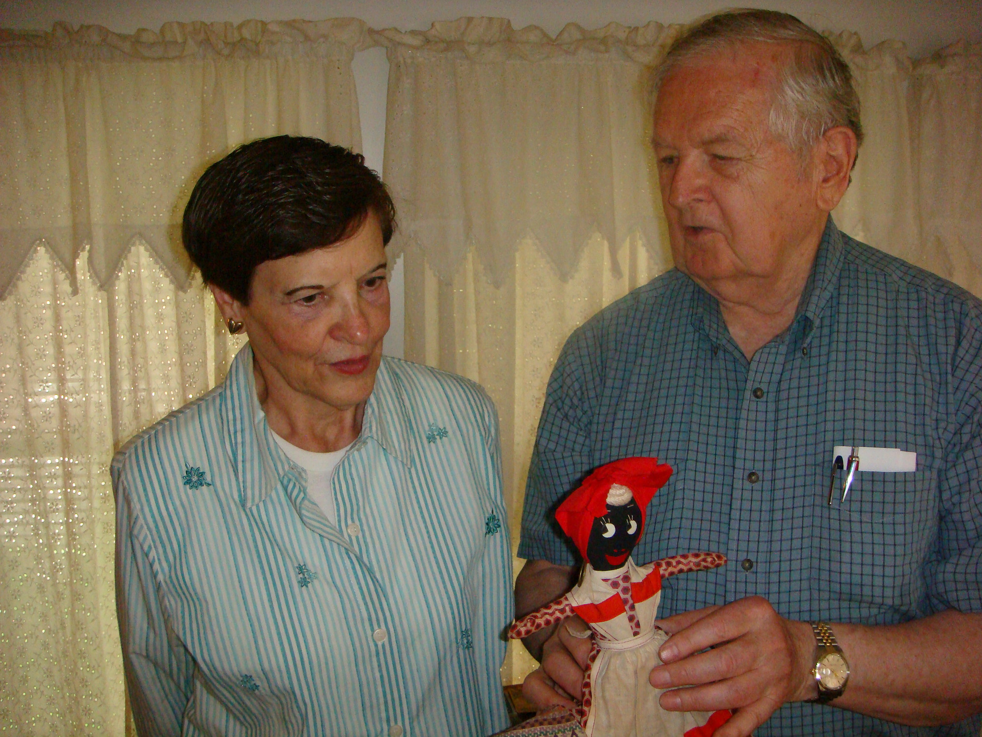 Marilyn Devlin and Frank Seipp showed off a servant's tospy-turvy doll.