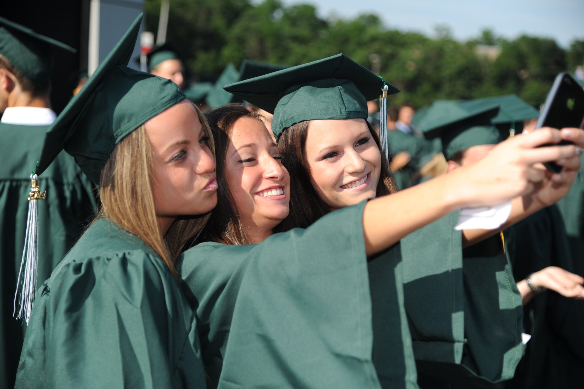 Shooting a selfie were, from left, Carly Grisar, 17, Brooke Gossert, 17, and Isabelle Greenbaum, 18.