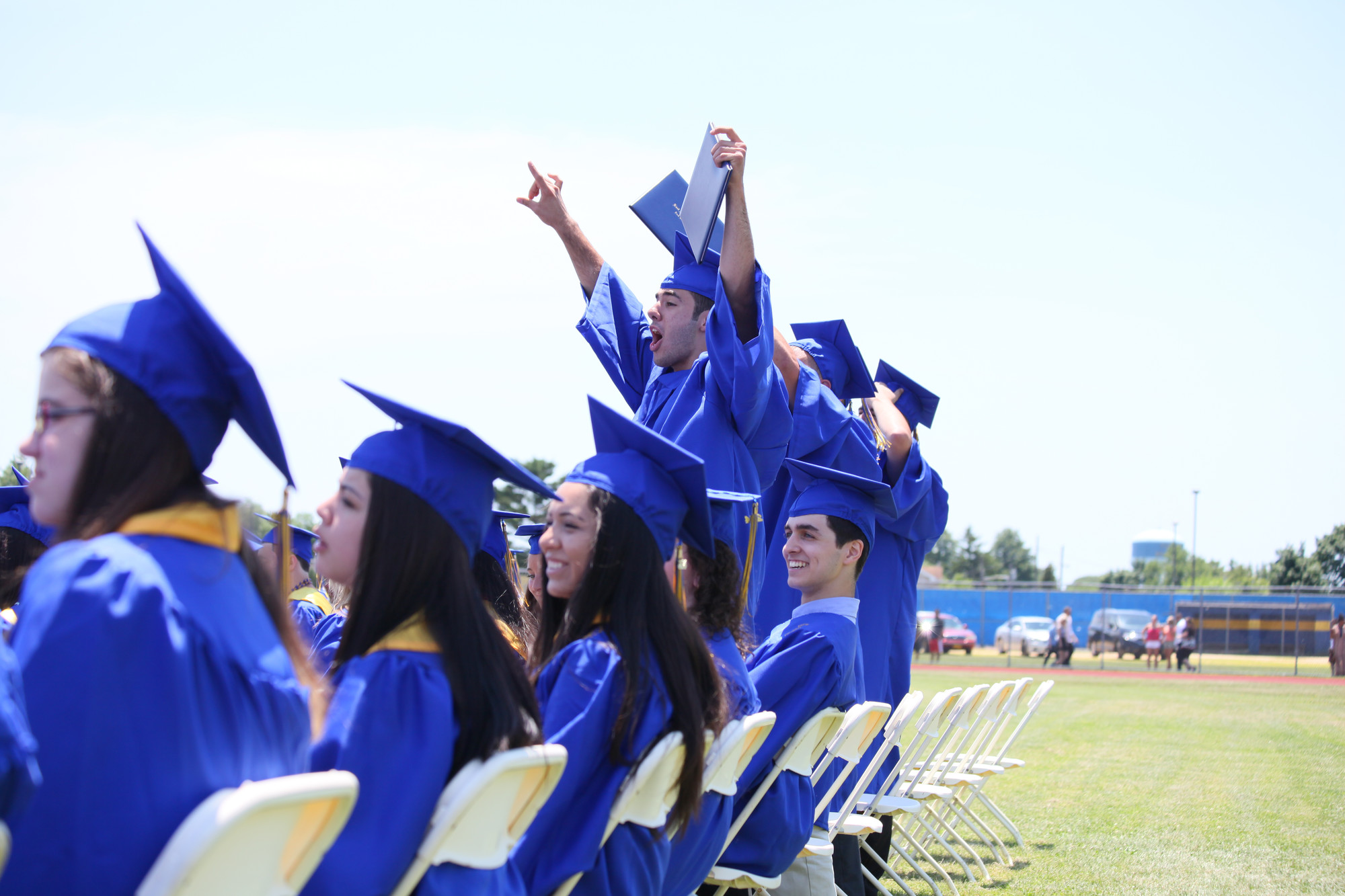 graduating seniors cheered as their classmates' names were called to receive their diplomas.