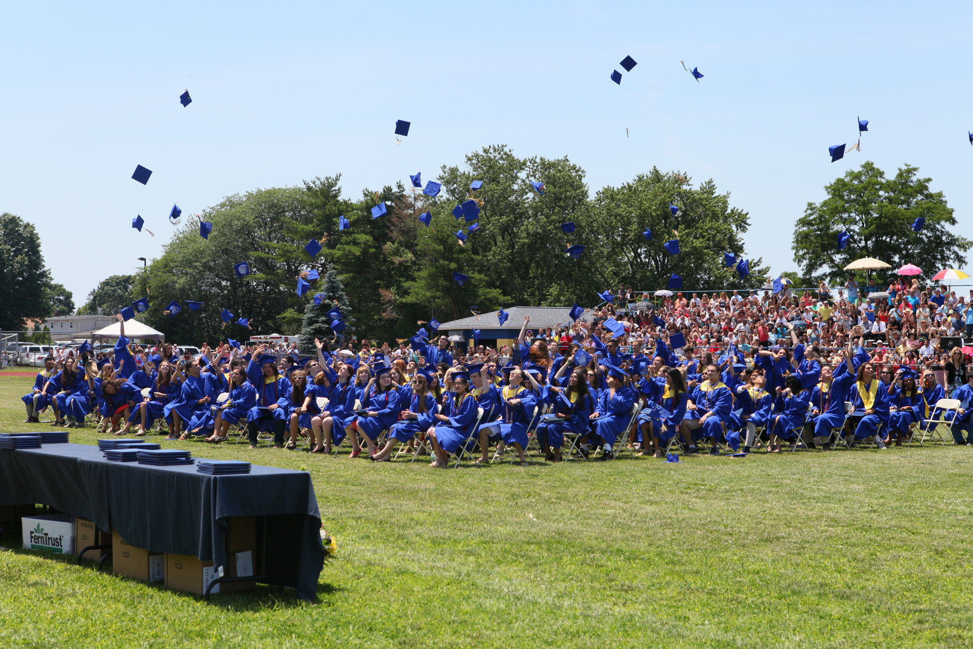 Students threw their caps in celebration as the East Meadow High School graduation ceremony concluded on June 29.