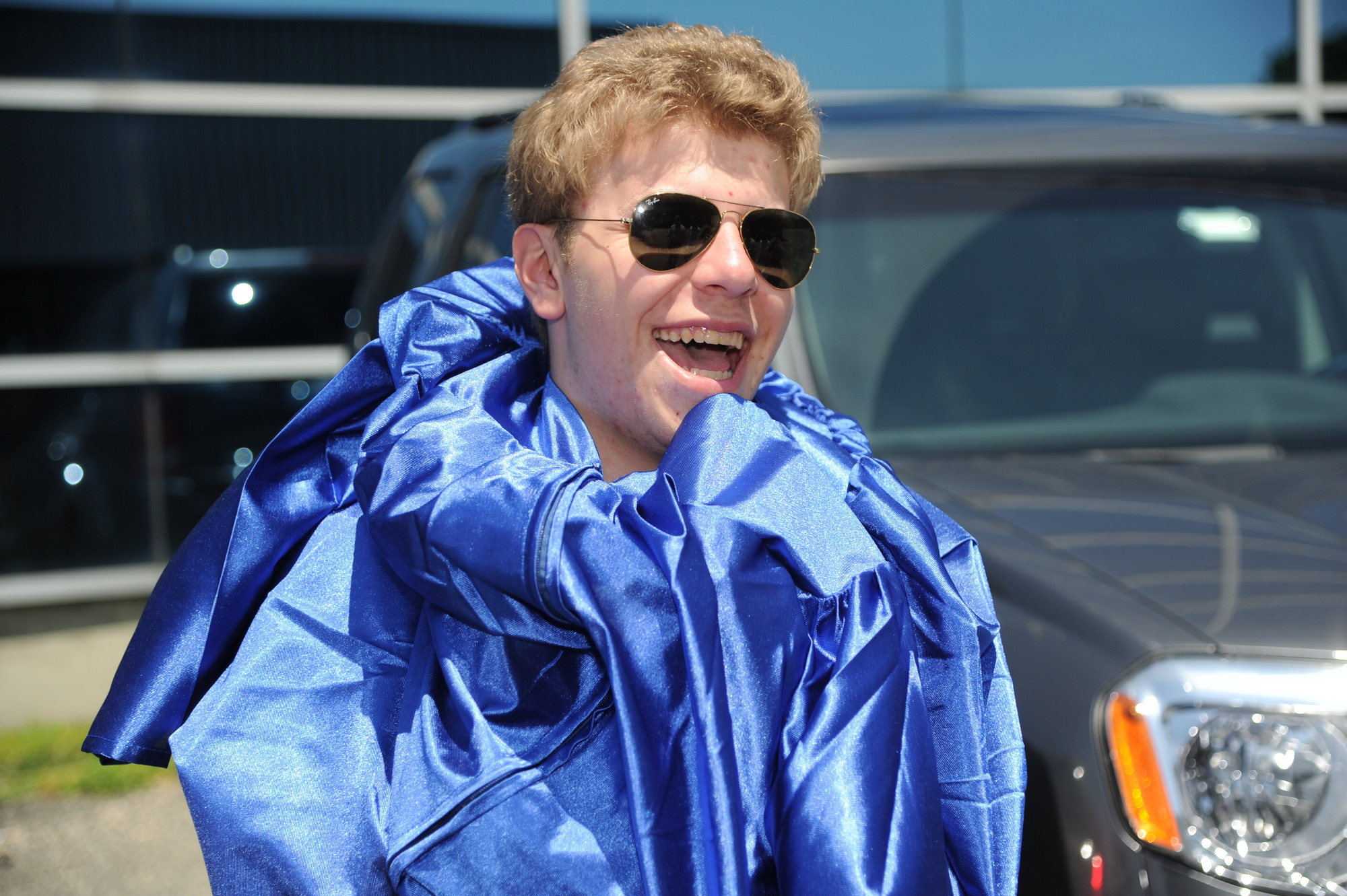 Jacob Garber had a laugh getting his robe on before commencement.