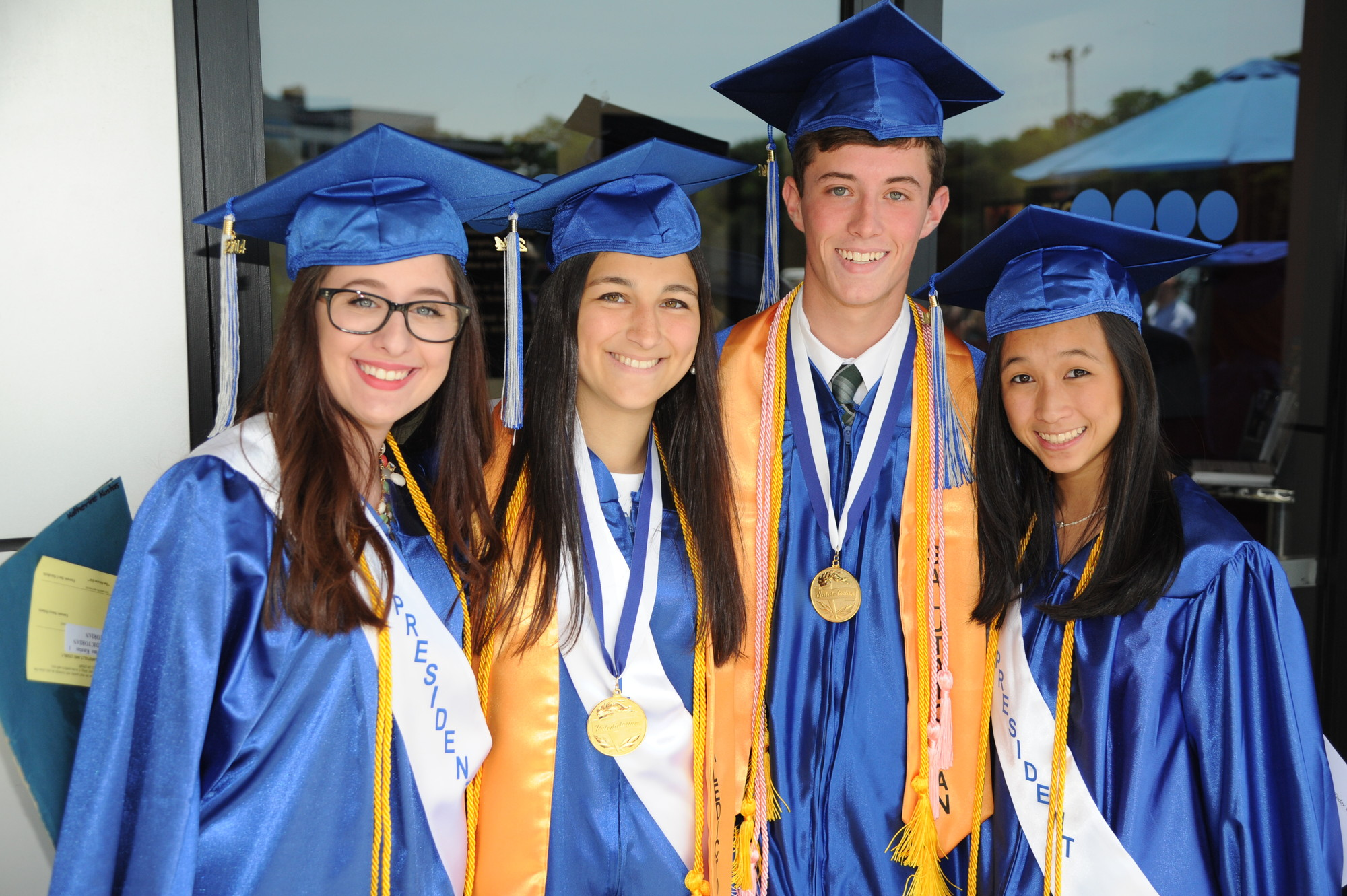 Class President Rebecca Peretz, valedictorian Katherine Kustas, salutatorian Alexander Boyd and Vice President Kaitlin Woo led the class of 2014.