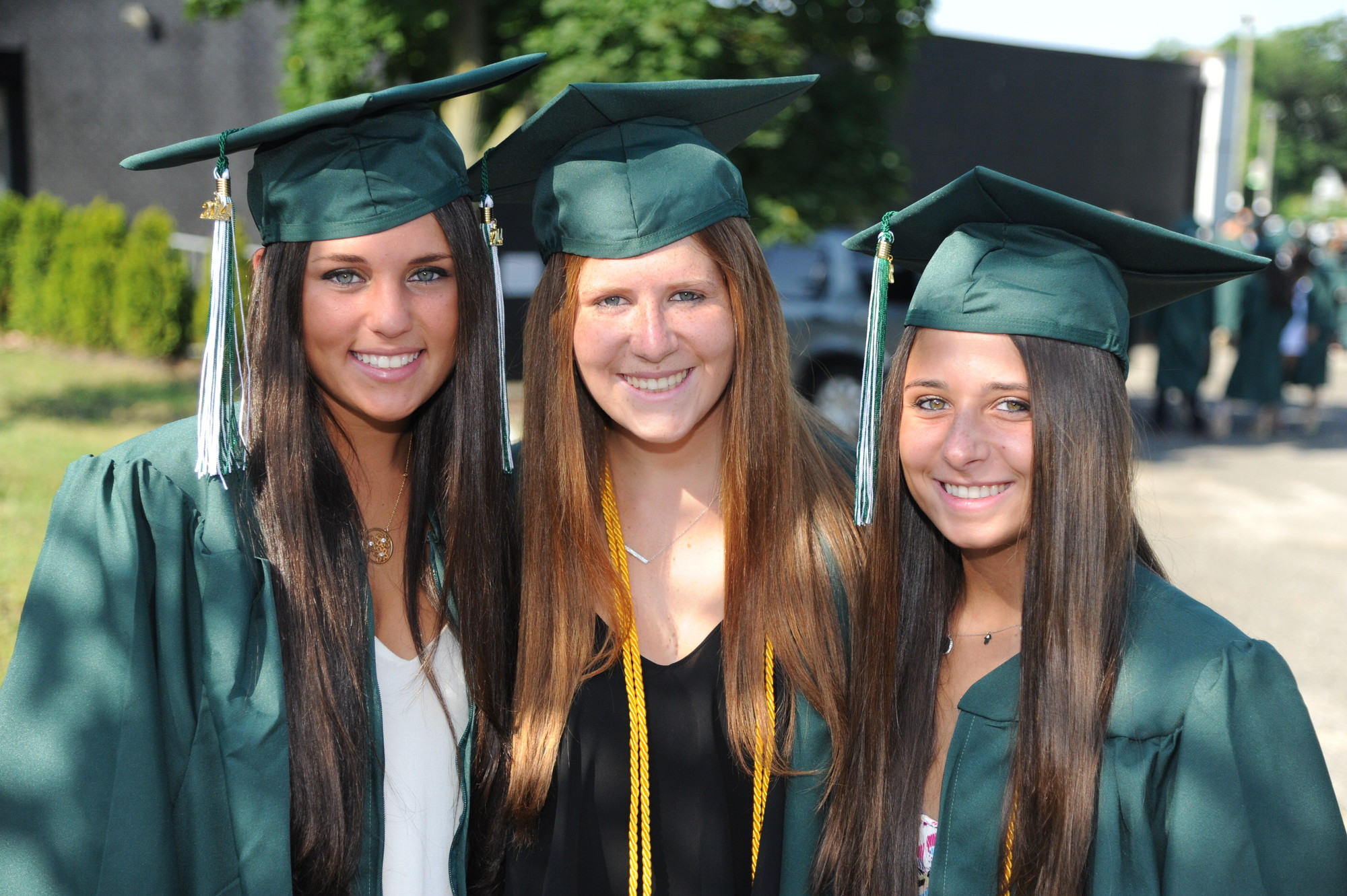 Kennedy High School seniors, from left, Casey King, Carly Klein and Hallie Katz were all smiles at graduation on Sunday.