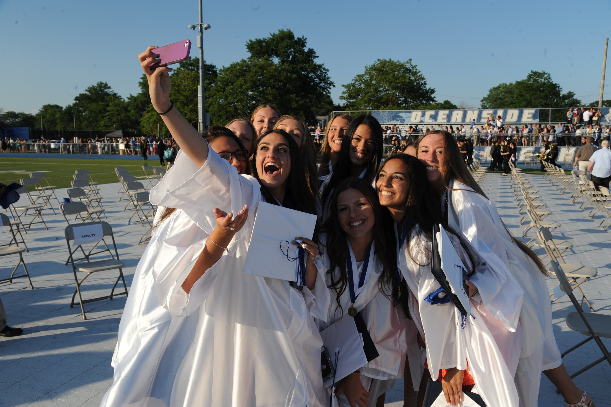 Taking a selfie, these graduates made sure to have a memento of their big day.