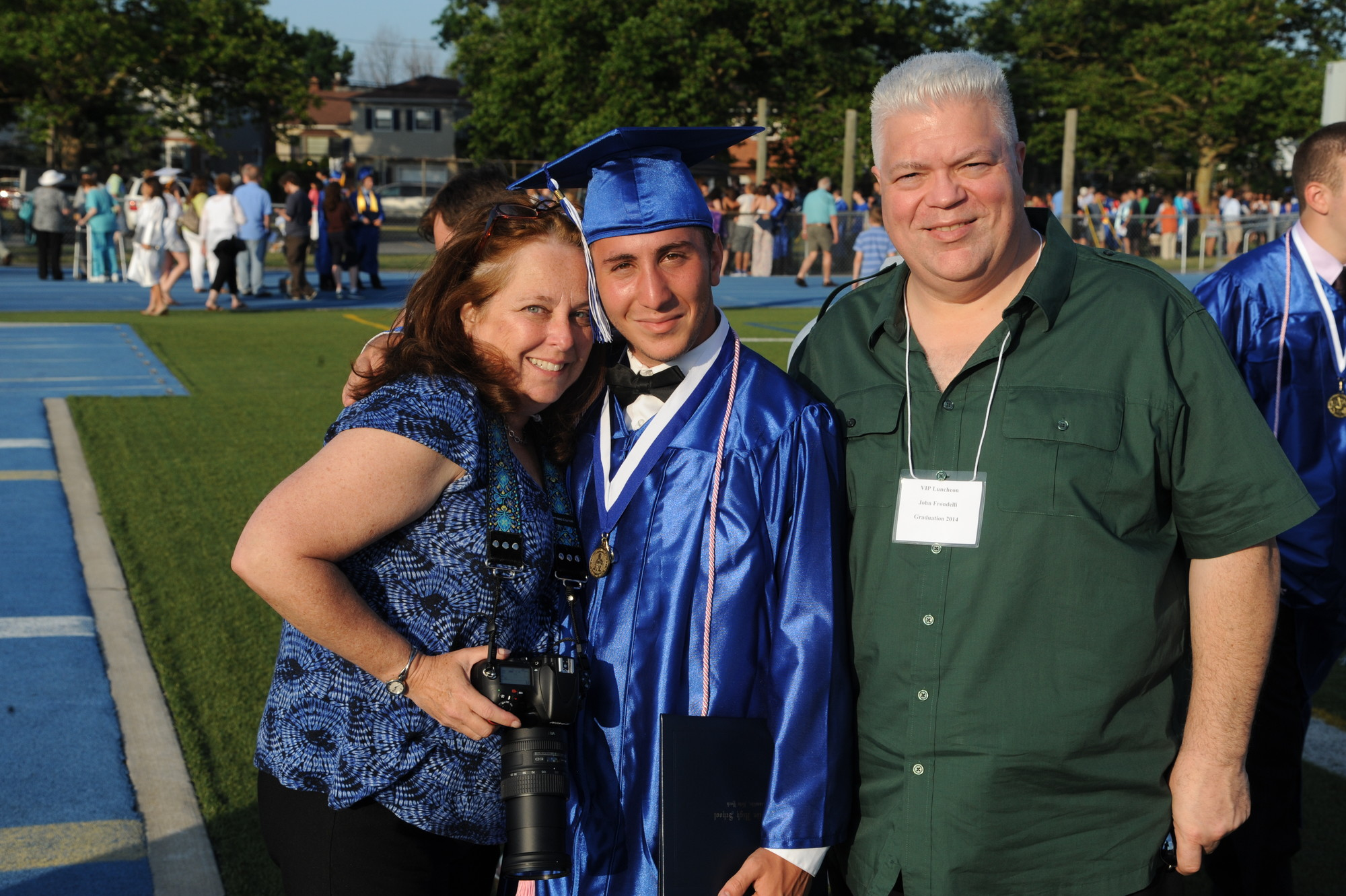 Alex Frondelli with parents Penny and John.