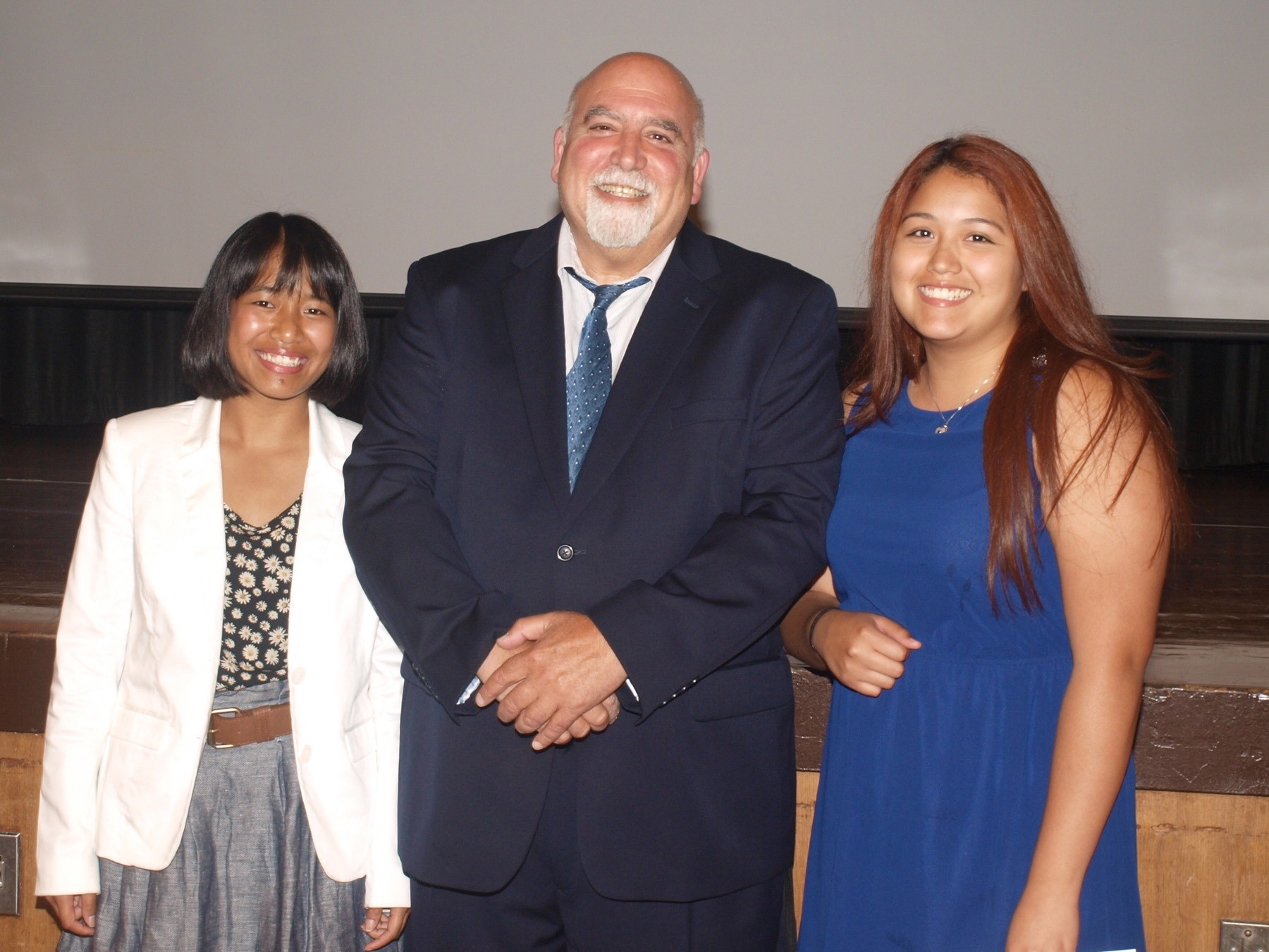 NEW YORK STATE NATIONAL SCIENCE HONOR SOCIETY: Freeport High School Science research teacher Edwin Irwin presented science fair first-place winner (left) Lynda L. Tinglin and third-place winner Stephanie Rodriguez at the 2014 science awards and New York State Science Honor Society induction. Second-place winner Alanna Gordon was not present at the event.