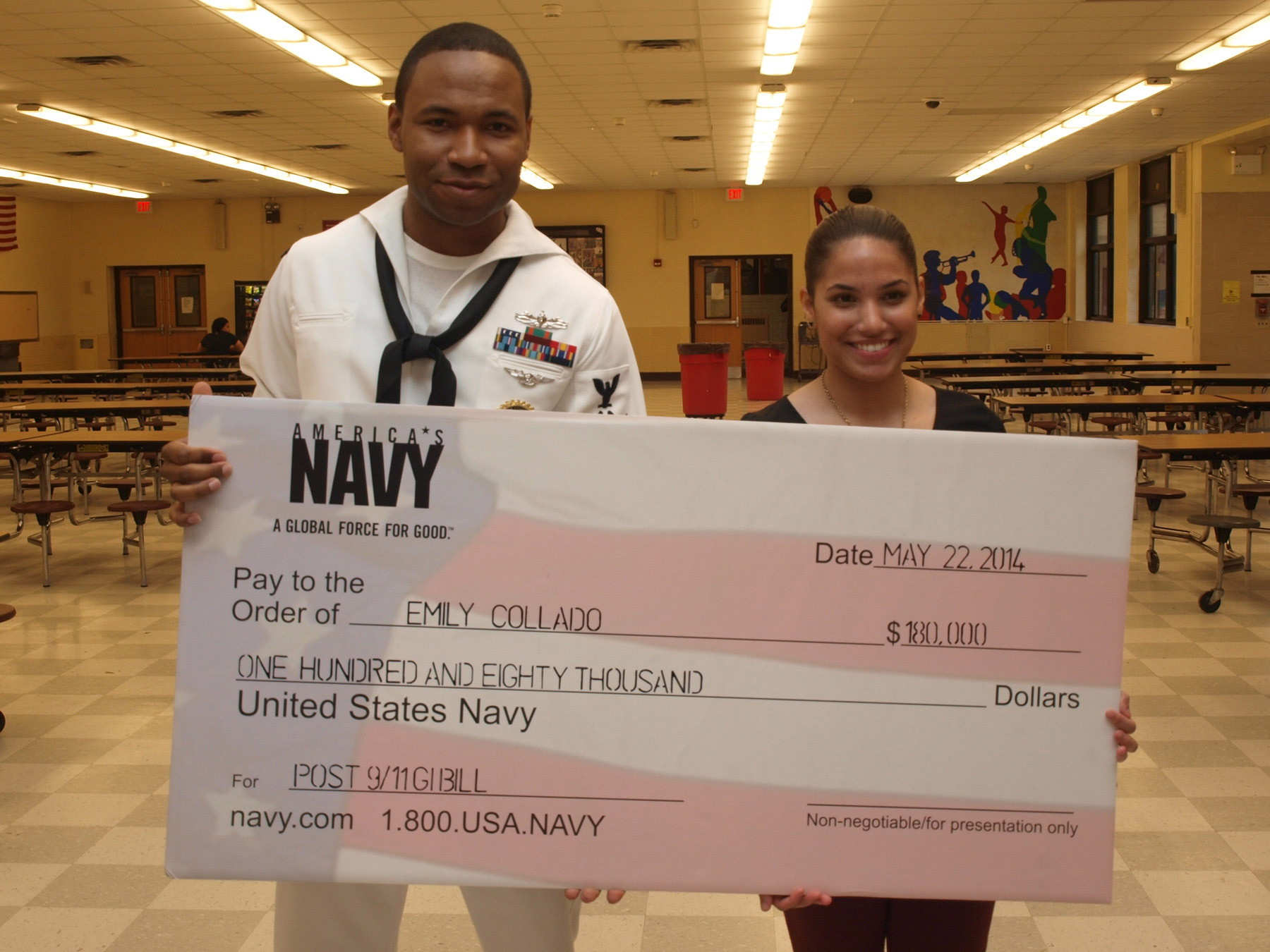SCHOLARSHIP RECEIPIENT: Freeport High School senior Emily Collado was awarded the $180,000 United States Navy G.I. Bill Scholarship by Petty Officer 2nd Class Jamal Joe.