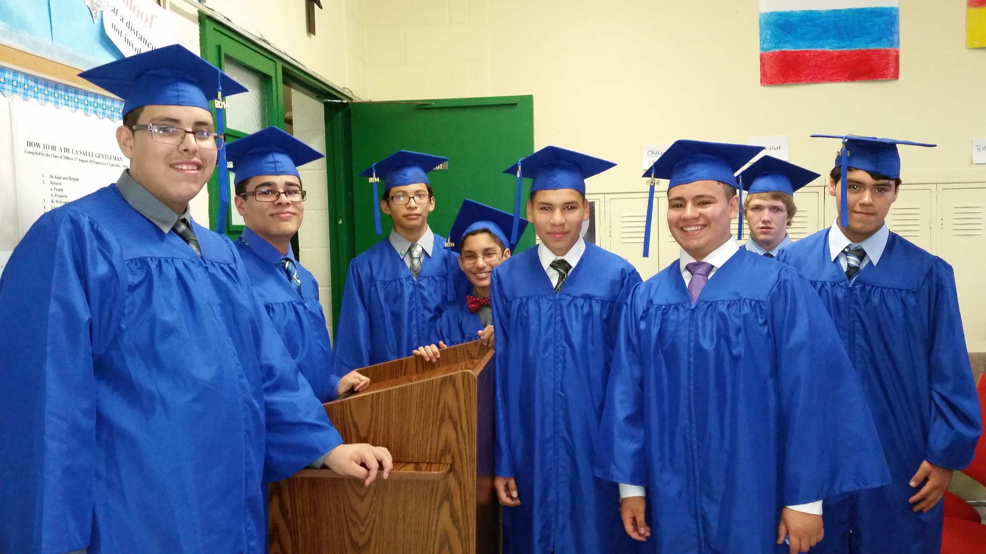 DE LA SALLE 2014 GRADUATES: Some of the graduates in the classroom before the ceremony on June 13. Fourteen young men graduated from the De La Salle Academy in Our Holy Redeemer Church in Freeport this year. From left are Jordy Duron, James Curry, Jason Gutierrez, Carlos Cabrera, Jerson Gonzalez, Jason Arbarca, Andre Nilov, and Steven Ortega.