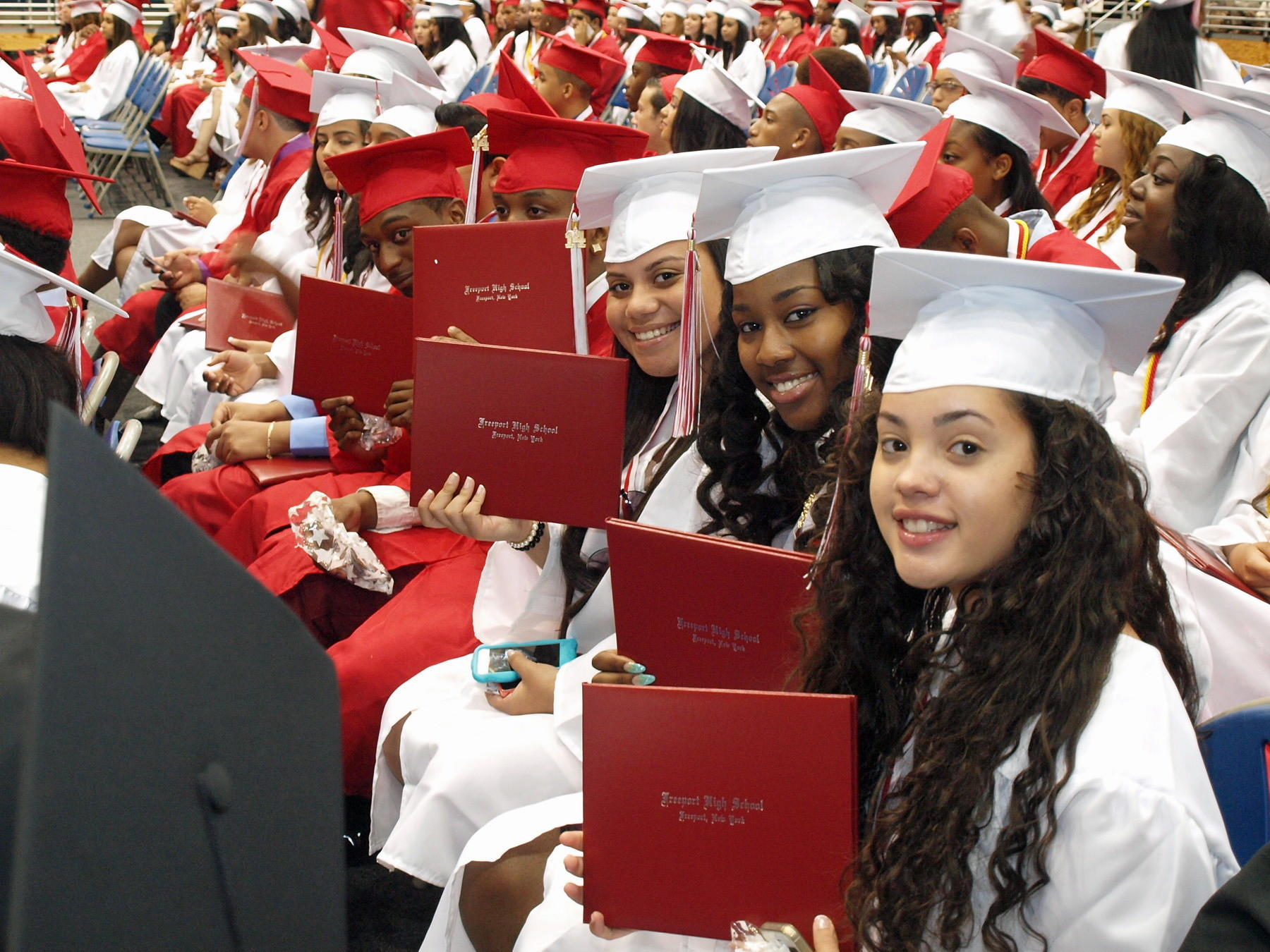 Freeport High School graduates of the class of 2014 proudly displayed their diploma holders. For the list of graduates and photographs from the ceremony.