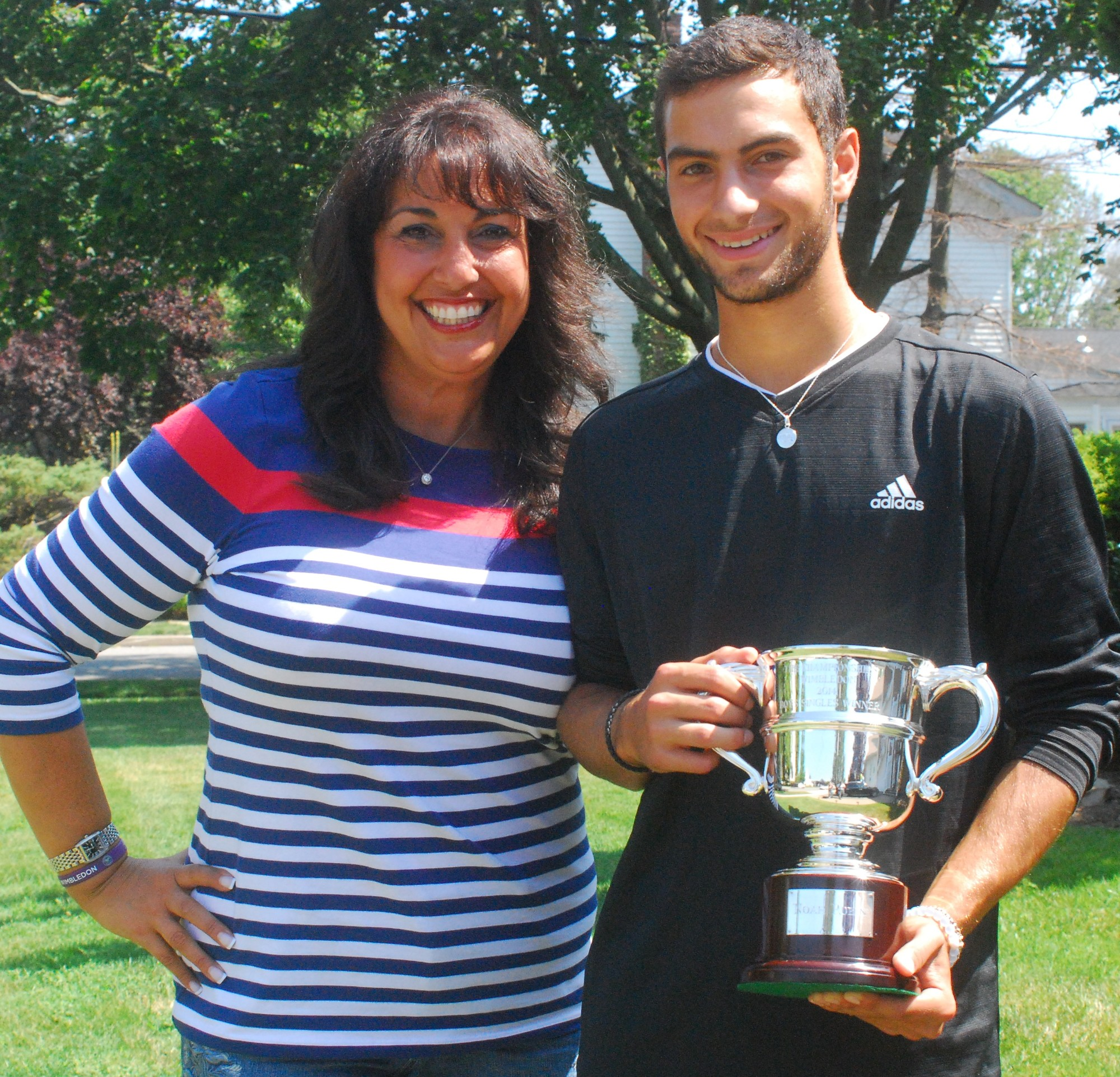 Rubin at home in Merrick on Monday with his mom, Melanie, and his Wimbledon trophy.