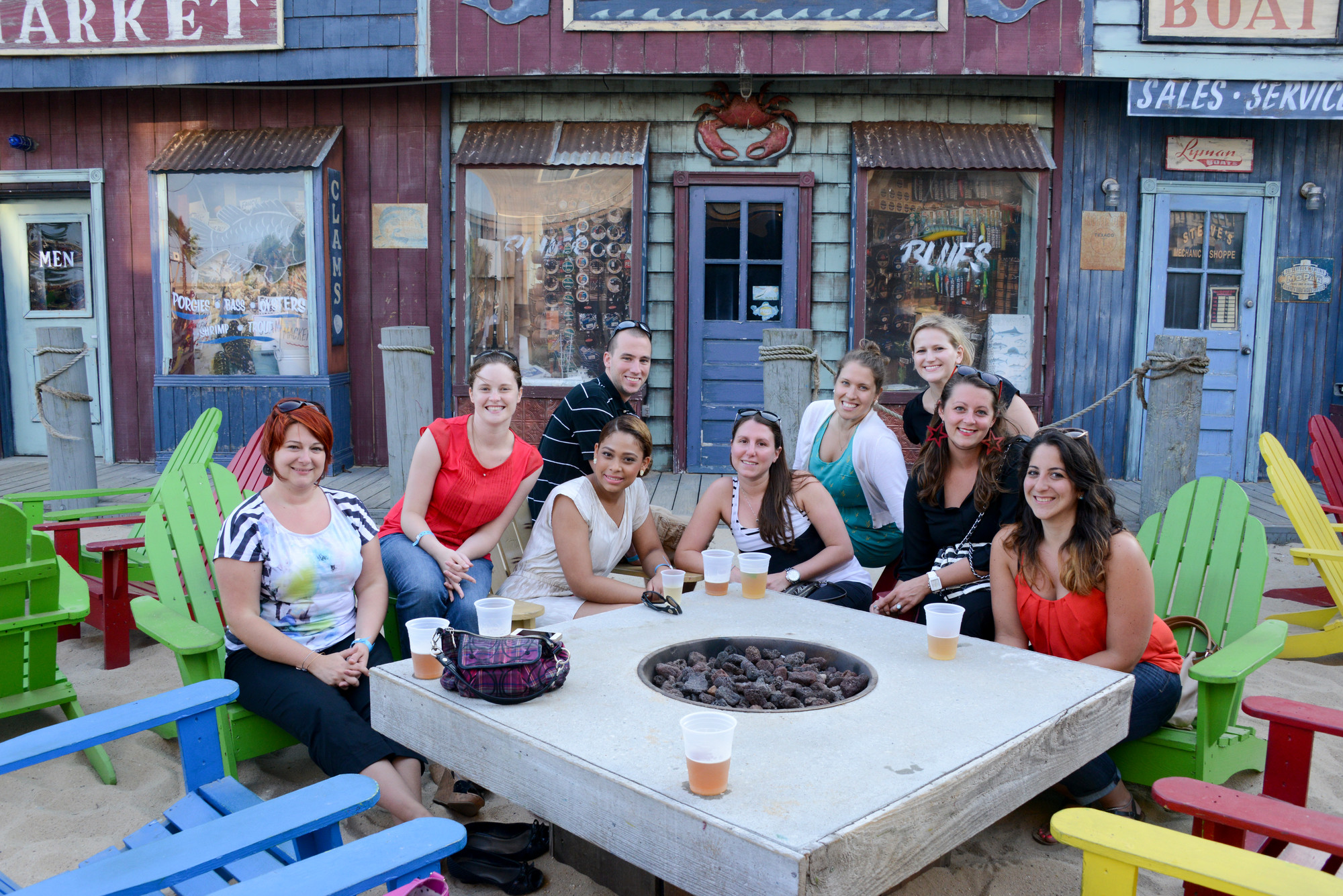 Sand, sun and suds. From left, Bridgett Barlett, Sammi Dahl, Misaury Jaquez, Eric Eggert, Nicole Lippel, Stephanie Ciantro, Samantha Barry, Amanda Schultze and Luciana Ventimiglia enjoy the scenery at Pop'S Seafood Shack.