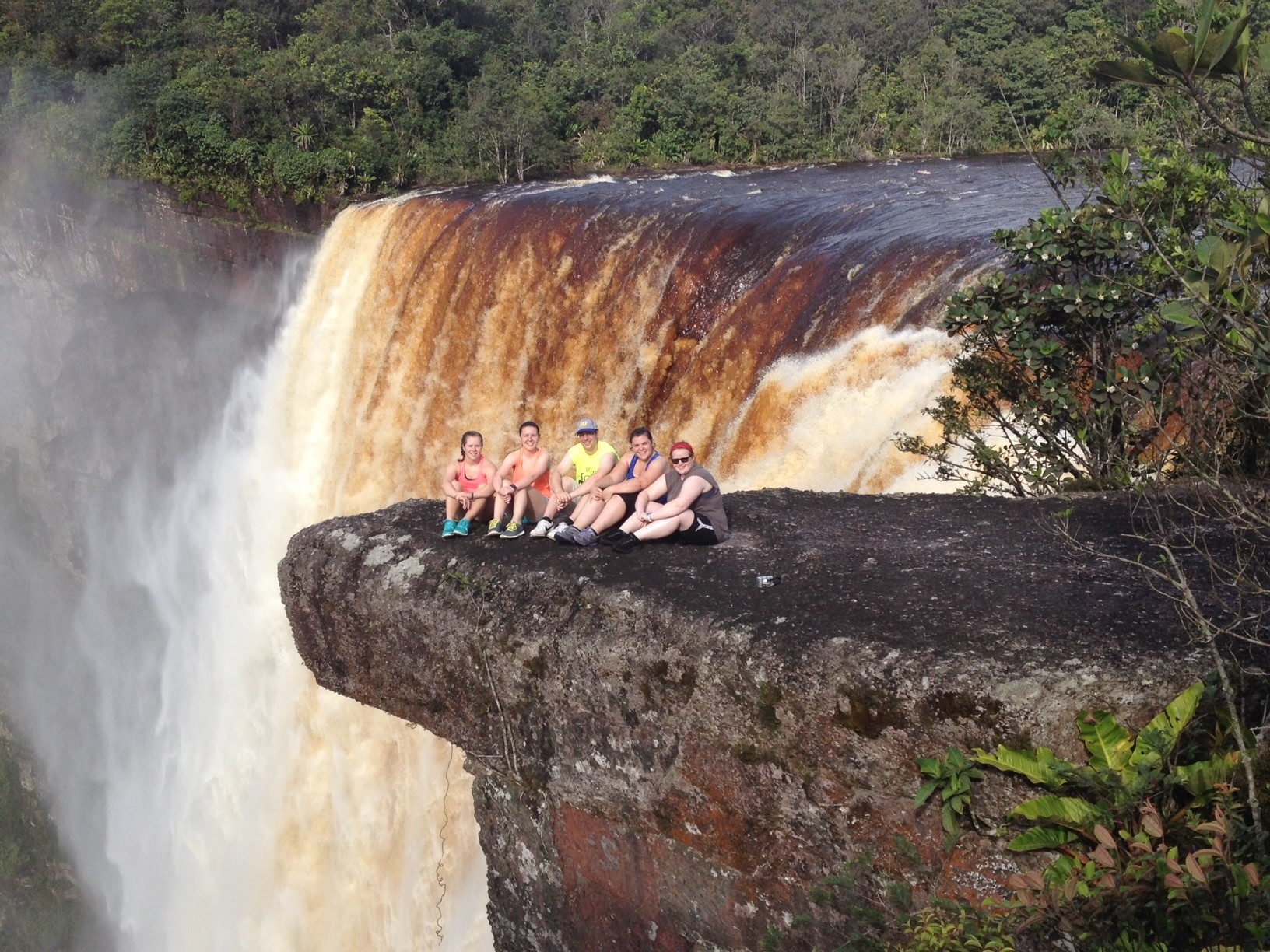 Kayleigh Morein, second from left, with her travel partners from Misericordia University at Kaieteur Falls in Guyana, a waterfall four times higher than Niagara Falls.
