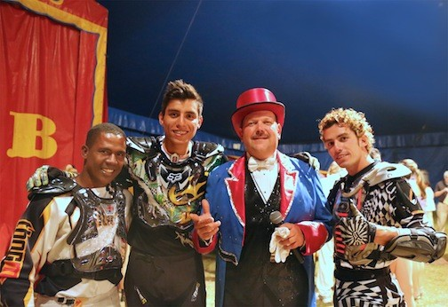 Ringmaster Chris Conners, center, shares a moment with the Thunderdrome Globe Riders. They�ll be at Eisenhower Park this weekend.