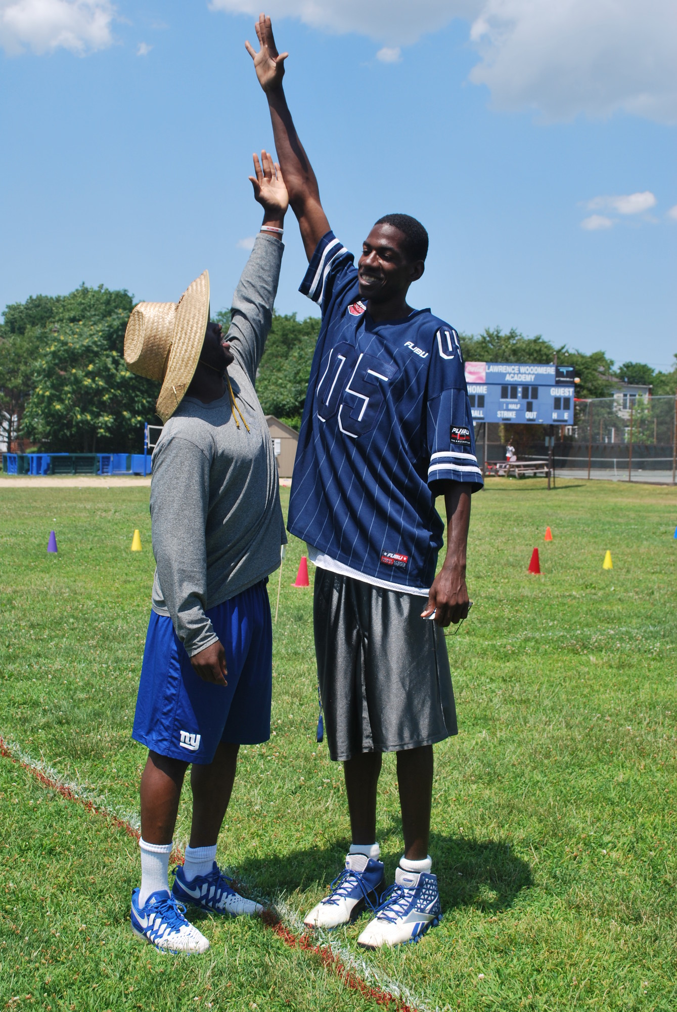 The long and short of it at Lawrence Woodmere Academy's summer camp. Karim Shabazz, right, outstretched Prince Amukamara.