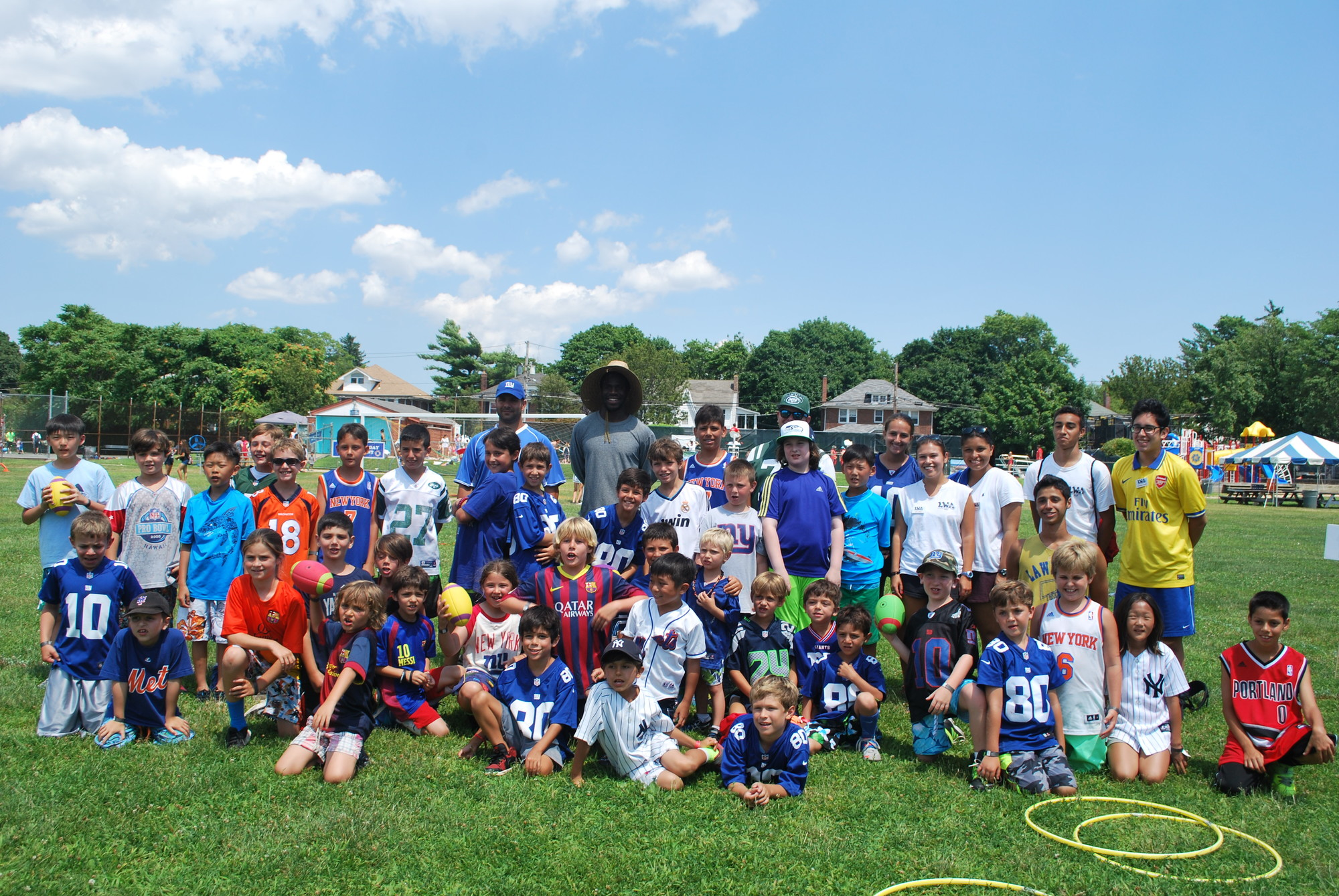 Champion Sports Academy campers and counselors with Giants cornerback Prince Amukamara, center right.